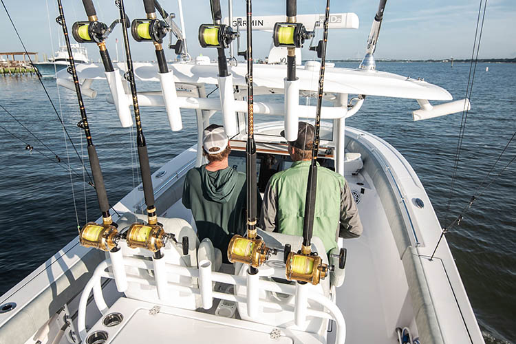 Picture of baitcasters in rod mounts on boat.