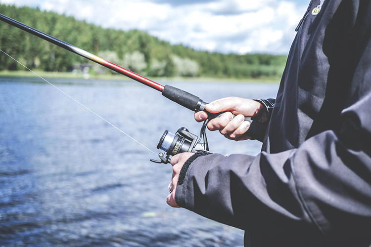 Picture of spinning reel in hand.