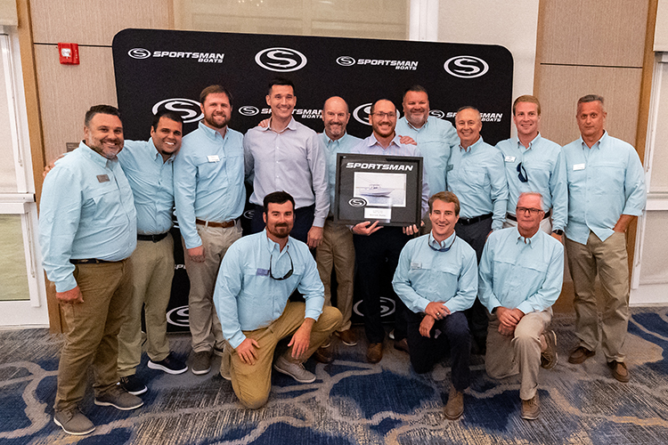 The Riverside Marine team receiving their top dealer award with the Sportsman executive team including Tommy Hancock, Russ Tomlinson, Richie Rodgers, Victor Gonzalez, Aaron Dumont and Bryan Greenwood.