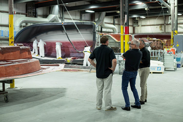 Image of Frank Hugelmeyer, Richie Rodgers and Russ Tomlinson taking a factory tour of the Sportsman Boats' facilities in South Carolina