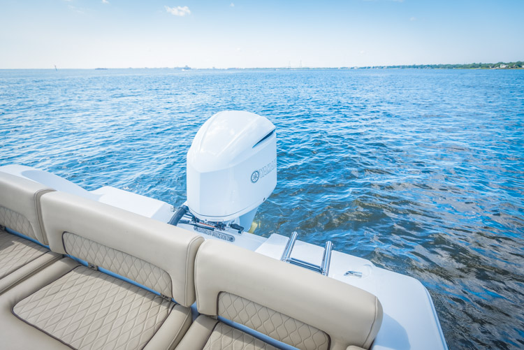 The brand new Sportsman Heritage 241 center console with a white custom painted Yamaha F300 outboard