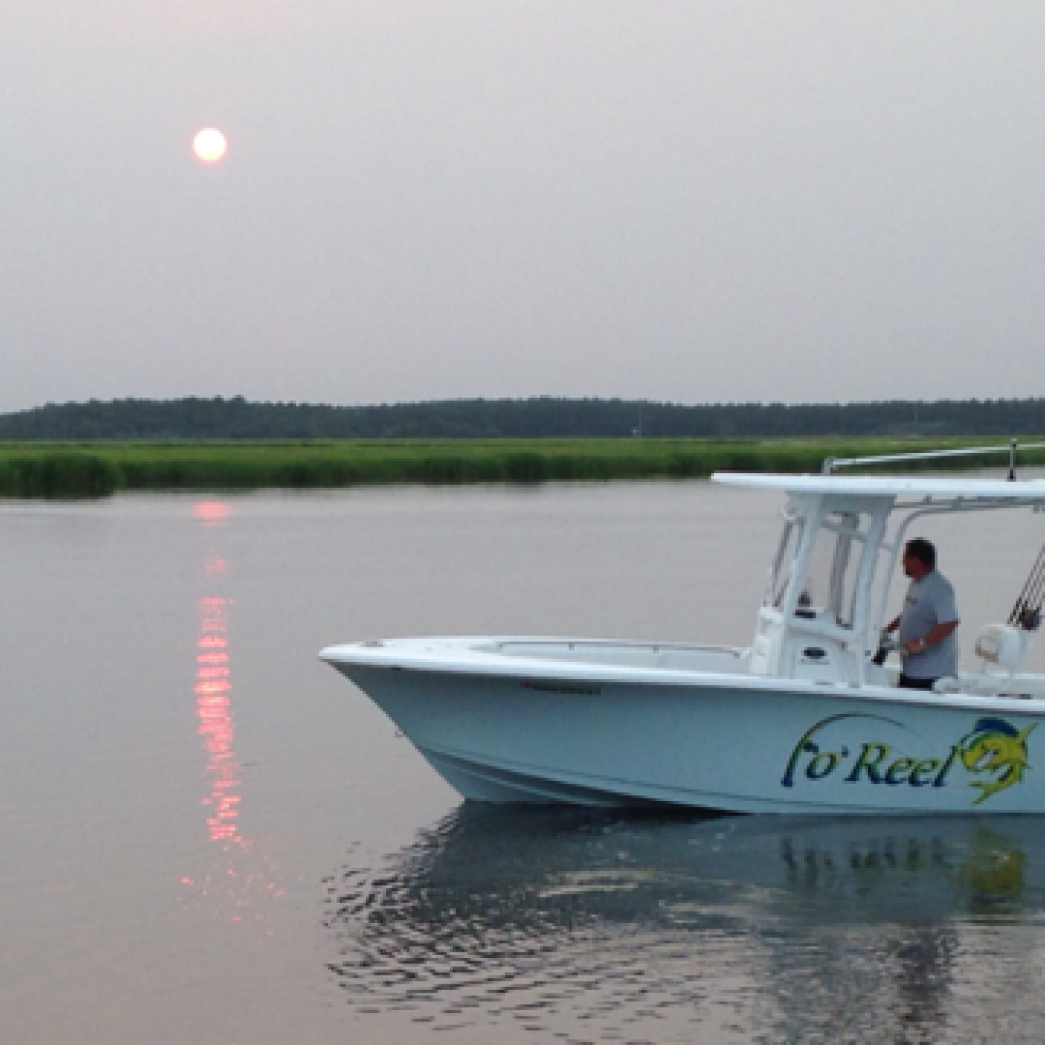 Title: Fo Reel - On board their Sportsman Heritage 231 Center Console - Location: Richmond Hill, Georgia. Participating in the Photo Contest #SportsmanDecember2015
