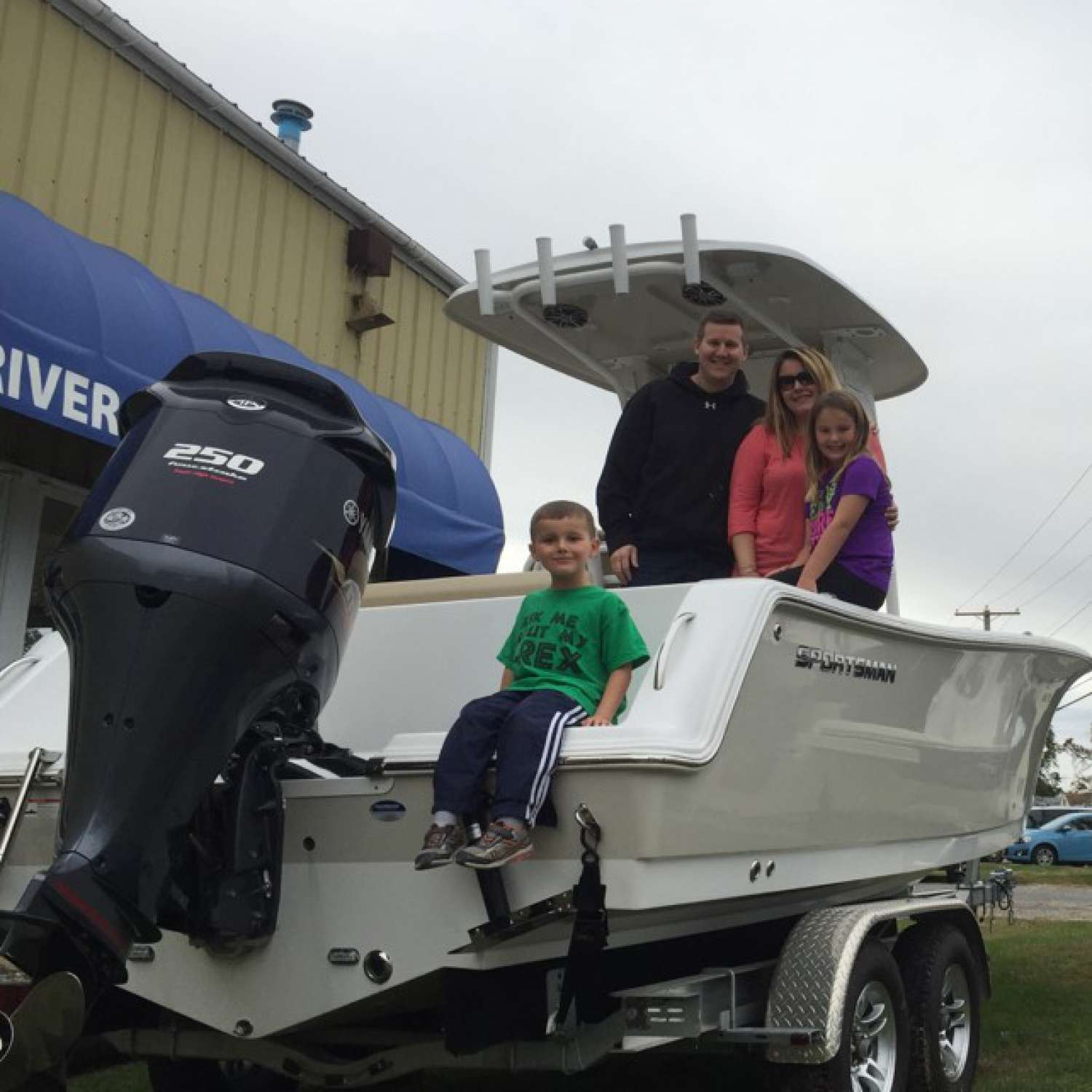 Title: Family Pic - On board their Sportsman Open 232 Center Console - Location: Baltimore, Maryland. Participating in the Photo Contest #SportsmanNovember2015