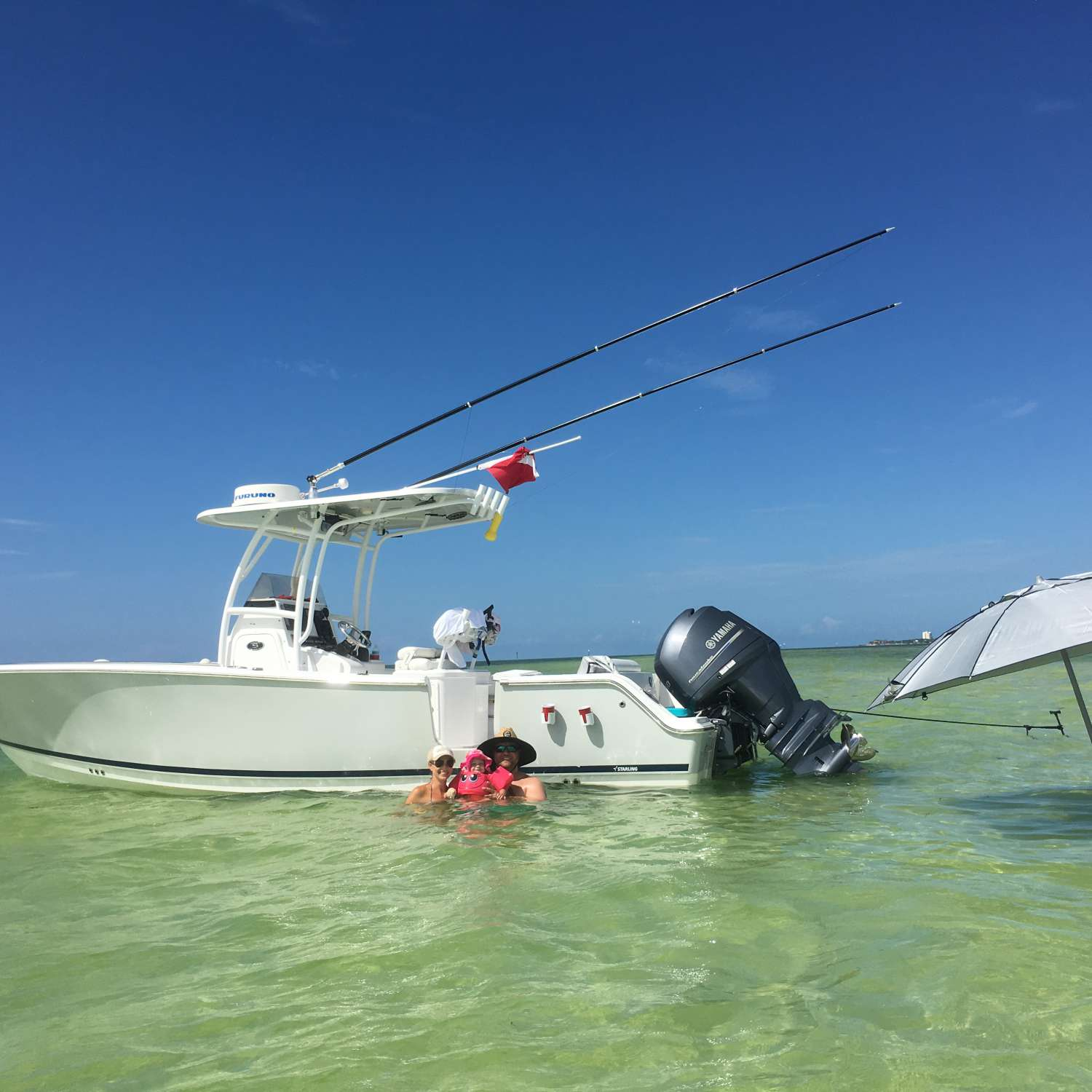 Title: Family Day - On board their Sportsman Heritage 251 Center Console - Location: Clermont, Florida. Participating in the Photo Contest #SportsmanAugust2016
