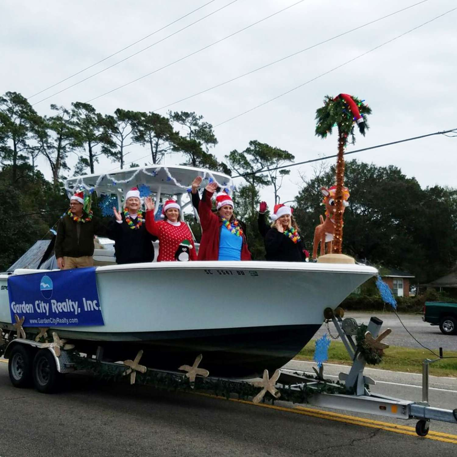 Title: Christmas Parading In Our Sportsman - On board their Sportsman Heritage 231 Center Console - Location: Garden City Beach, South Carolina. Participating in the Photo Contest #SportsmanDecember2016