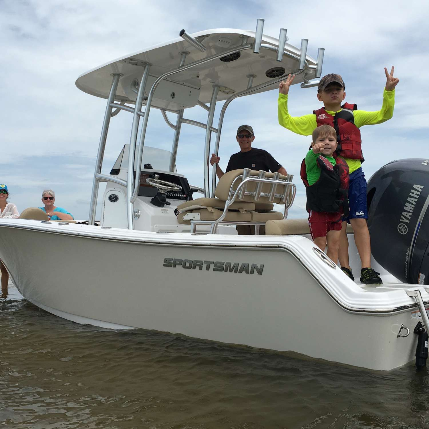 Title: Family Fun - On board their Sportsman Heritage 211 Center Console - Location: Melbourne Beach, Florida. Participating in the Photo Contest #SportsmanJuly2016