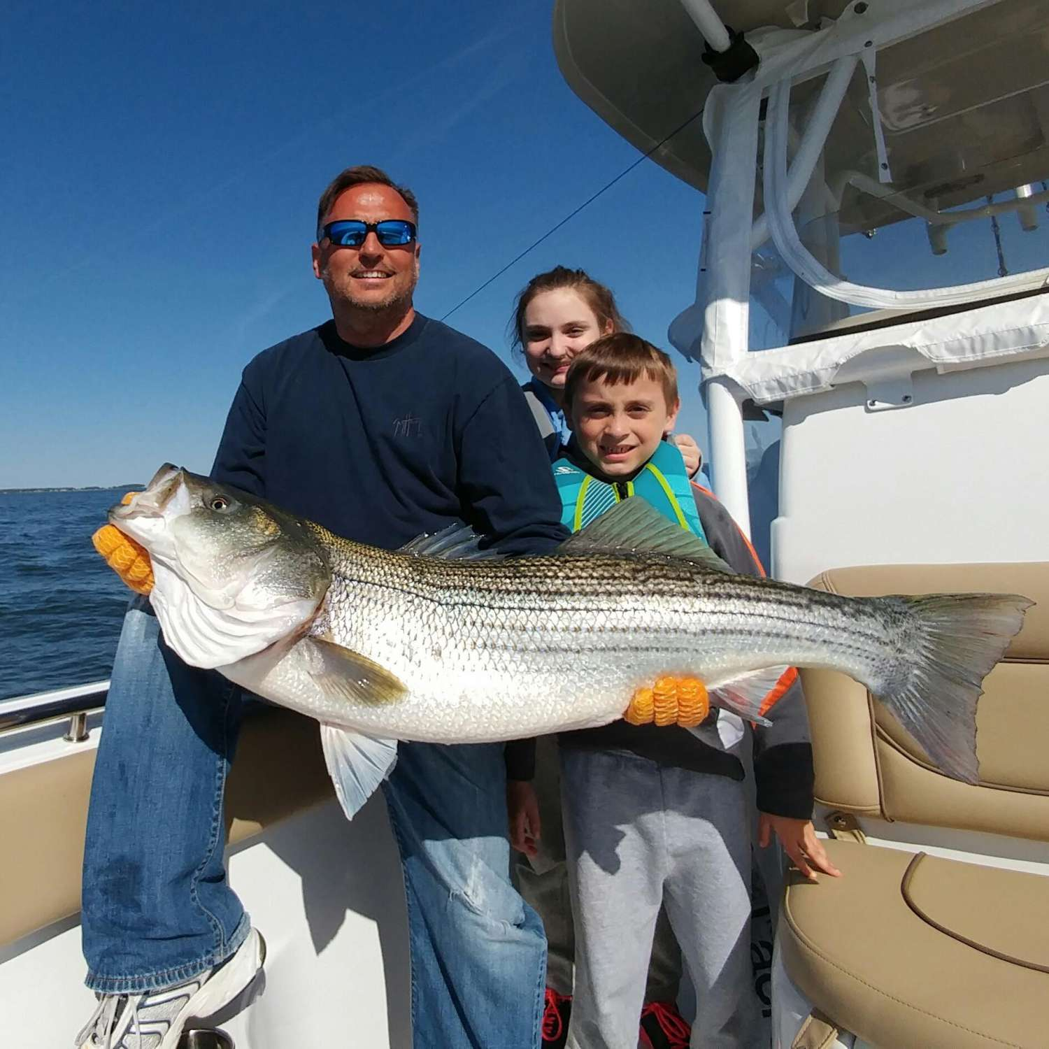 Title: Monster Striper - On board their Sportsman Open 252 Center Console - Location: Grasonville, Maryland. Participating in the Photo Contest #SportsmanMay2016
