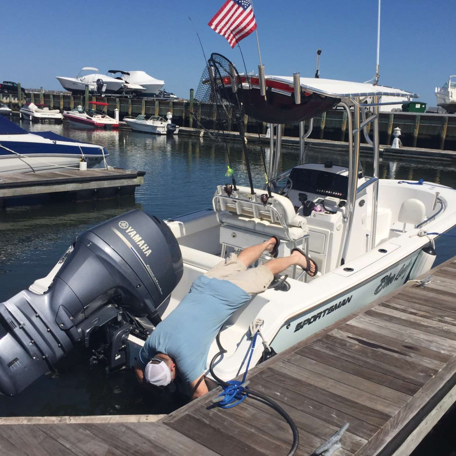 Title: Cleaning The Trim Tabs - On board their Sportsman Open 212 Center Console - Location: Estell Manor, New Jersey. Participating in the Photo Contest #SportsmanAugust2017