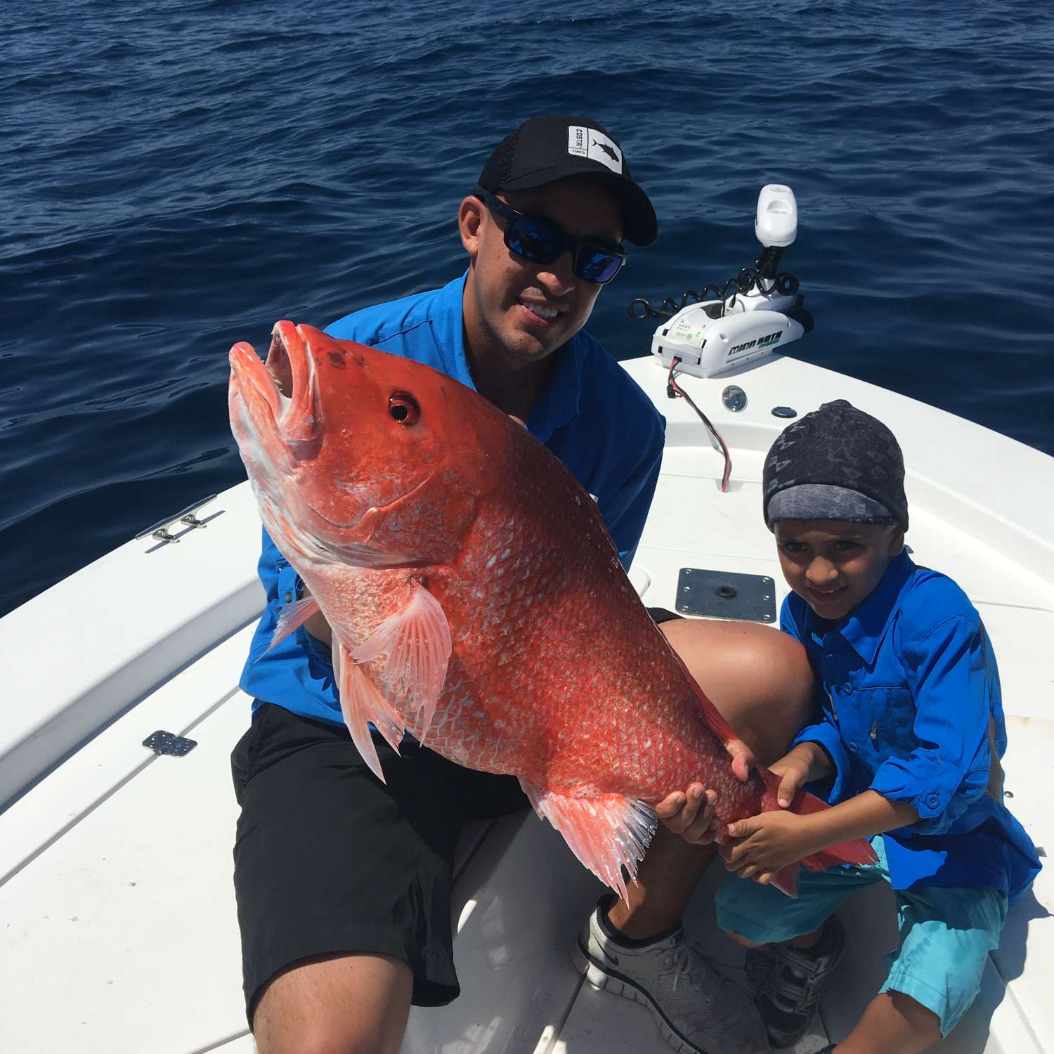 Title: Father Son Moment - On board their Sportsman Masters 247 Bay Boat - Location: Jacksonville, Florida. Participating in the Photo Contest #SportsmanAugust2017