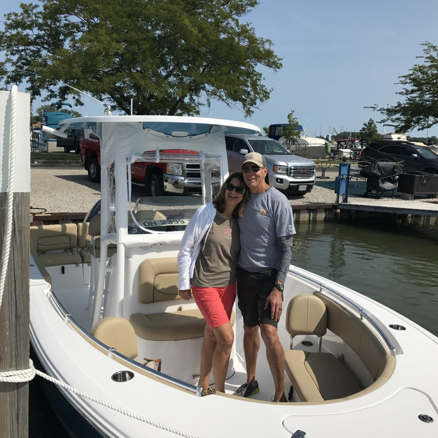 Title: Proud new owners! - On board their Sportsman Heritage 231 Center Console - Location: Marblehead, Ohio. Participating in the Photo Contest #SportsmanDecember2017