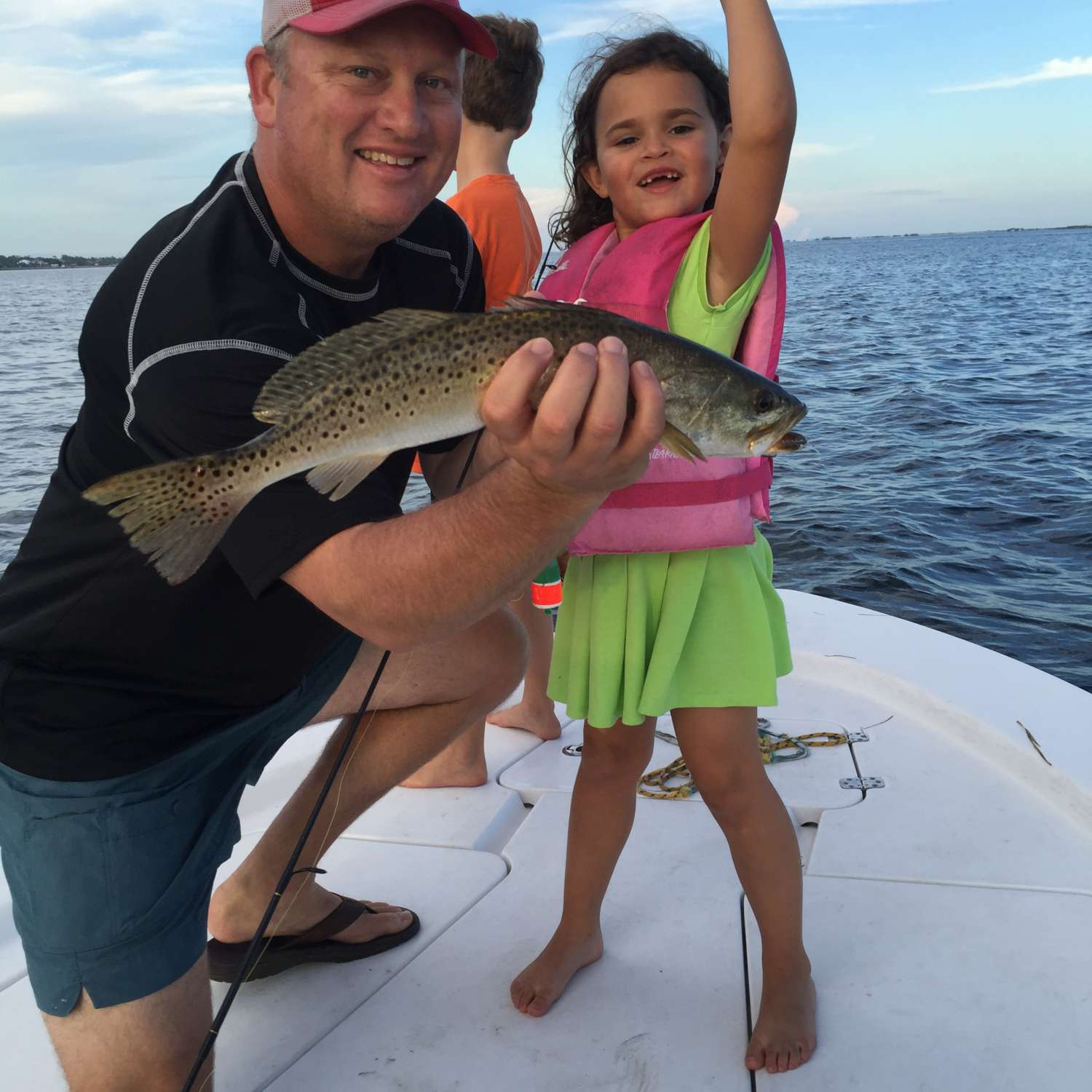 Title: Lil Girl And Lil Trout - On board their Sportsman Masters 207 Bay Boat - Location: Gulf Breeze, Florida. Participating in the Photo Contest #SportsmanFebruary2017