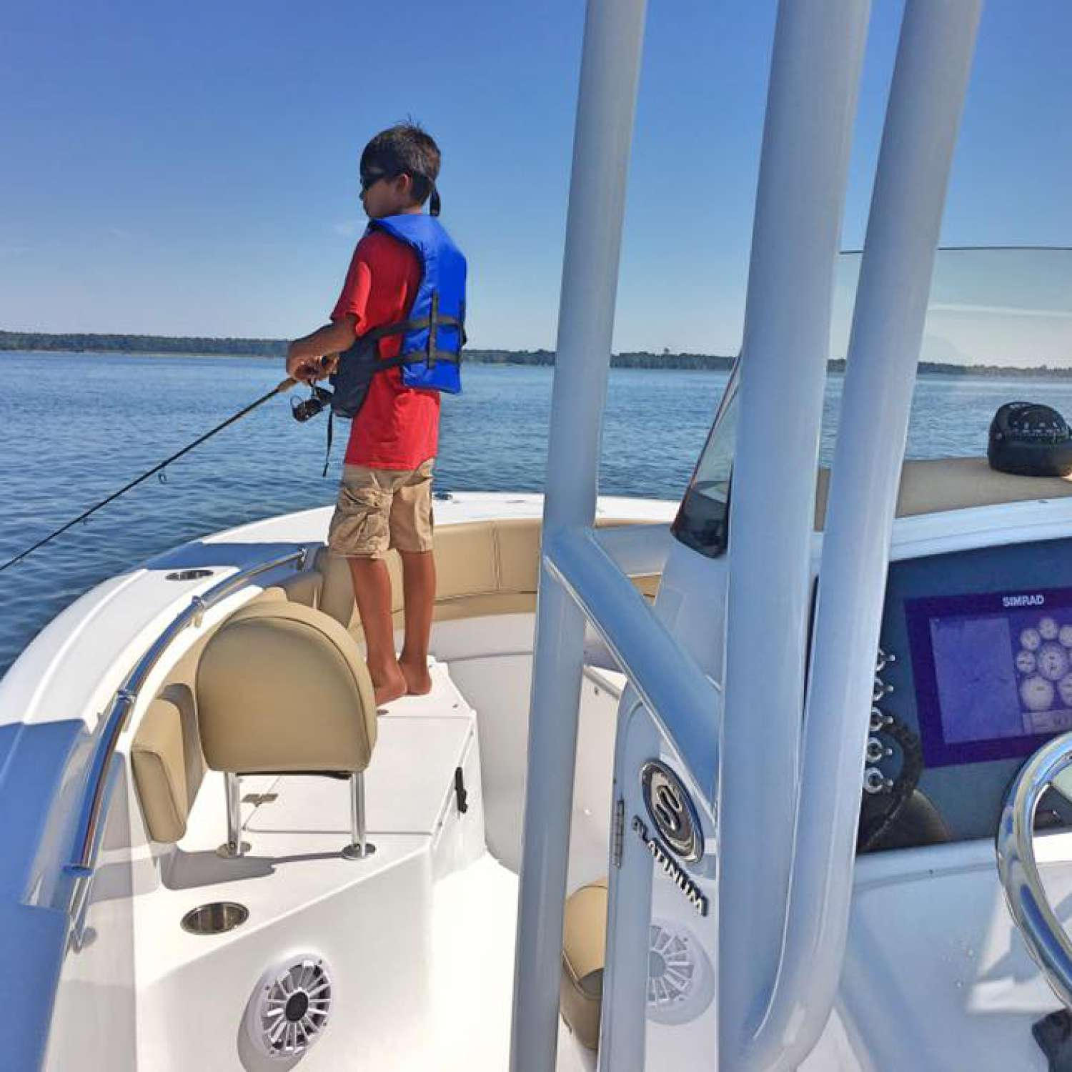 Title: Jigging Away - On board their Sportsman Open 232 Center Console - Location: Chester, Maryland. Participating in the Photo Contest #SportsmanJanuary2017