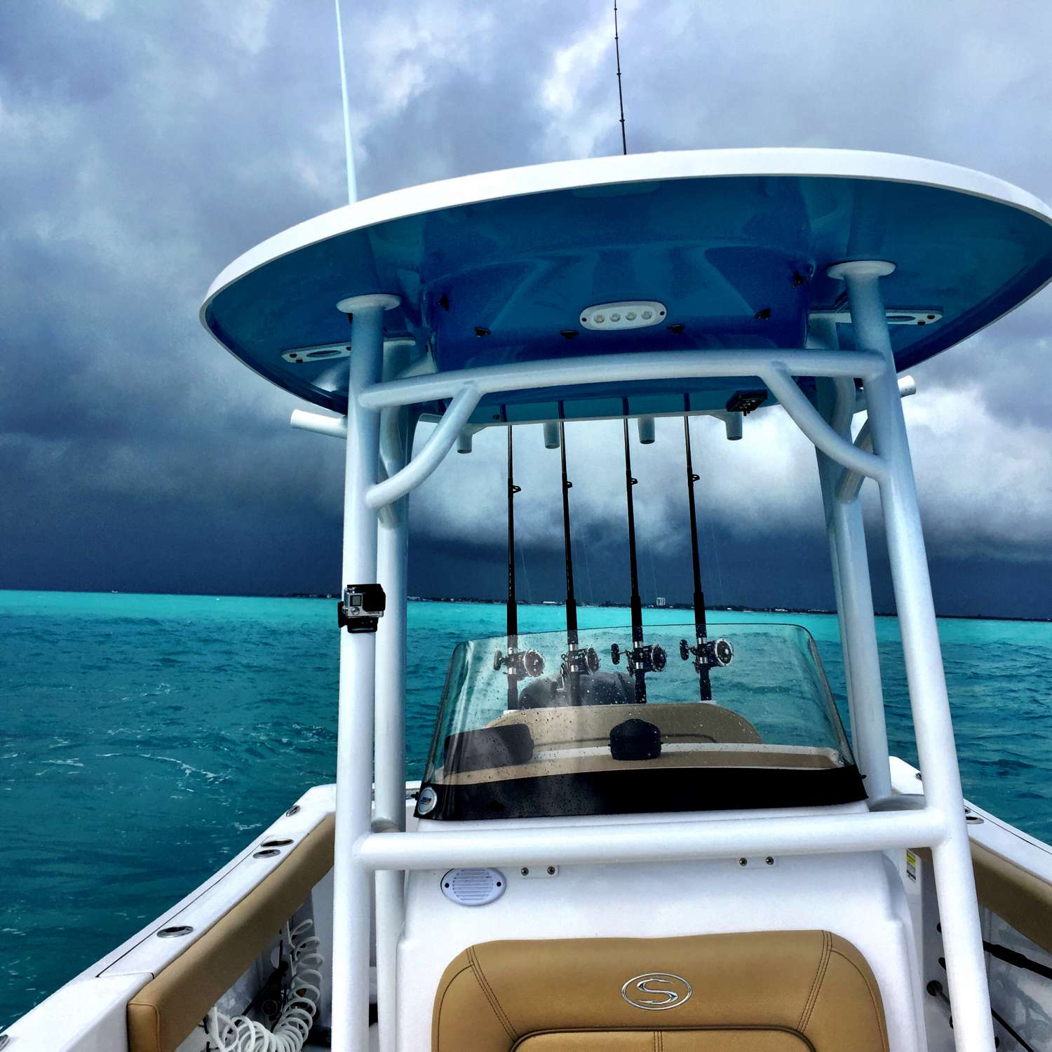 Title: Keys Afternoon Shower - On board their Sportsman Open 232 Center Console - Location: Jacksonville, Florida. Participating in the Photo Contest #SportsmanJanuary2017