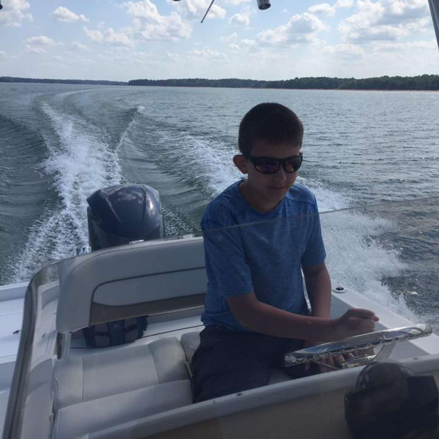Title: Young Captain - On board their Sportsman Masters 247 Bay Boat - Location: Greenville, South Carolina. Participating in the Photo Contest #SportsmanJune2017