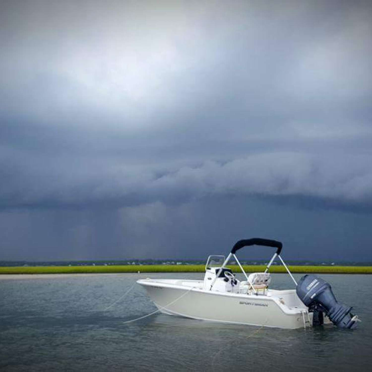 Title: The Calm Before The Storm - On board their Sportsman Heritage 211 Center Console - Location: Hampstead, North Carolina. Participating in the Photo Contest #SportsmanMarch2017