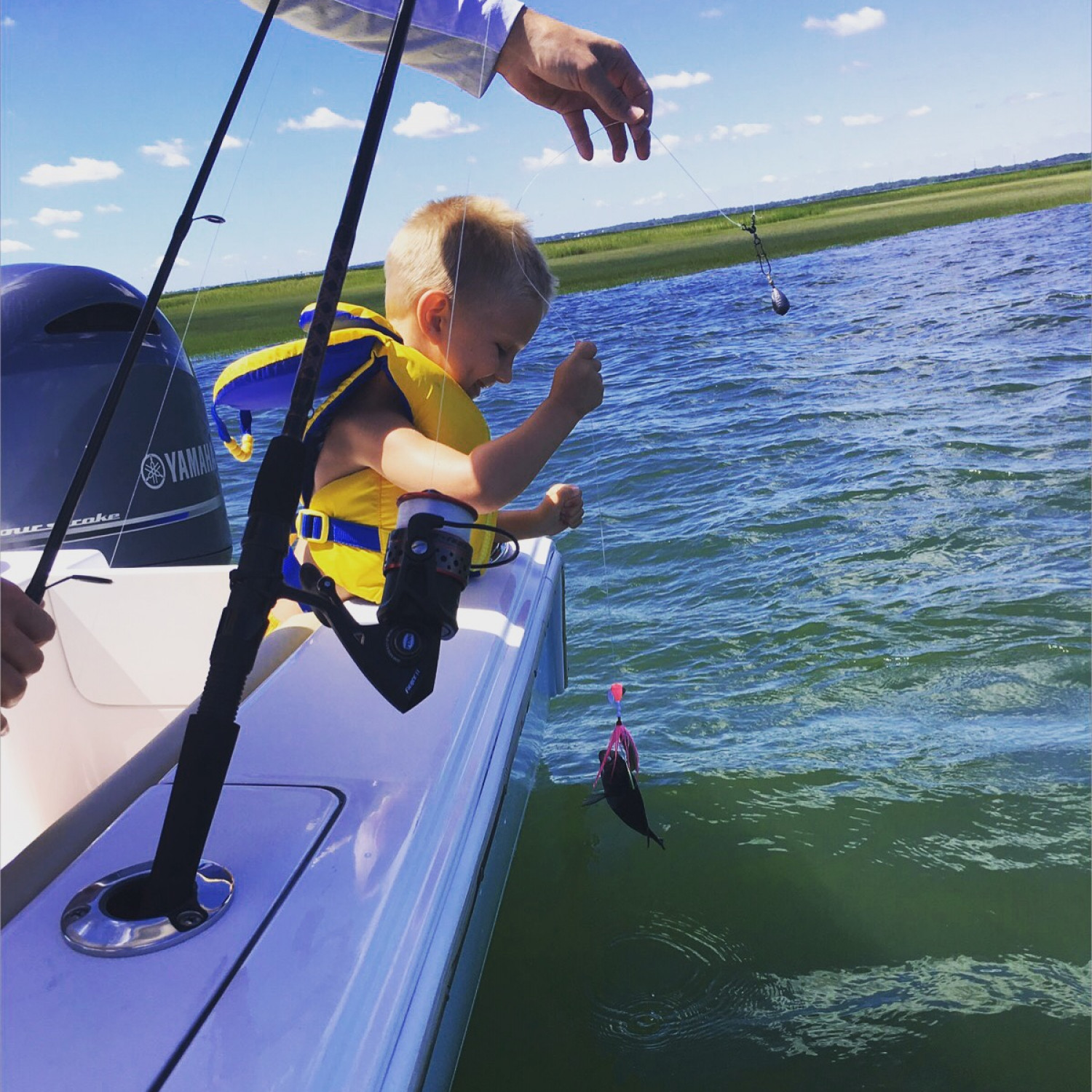 Title: First catch! - On board their Sportsman Open 212 Center Console - Location: Sea Isle City, Nee Jersey. Participating in the Photo Contest #SportsmanNovember2017