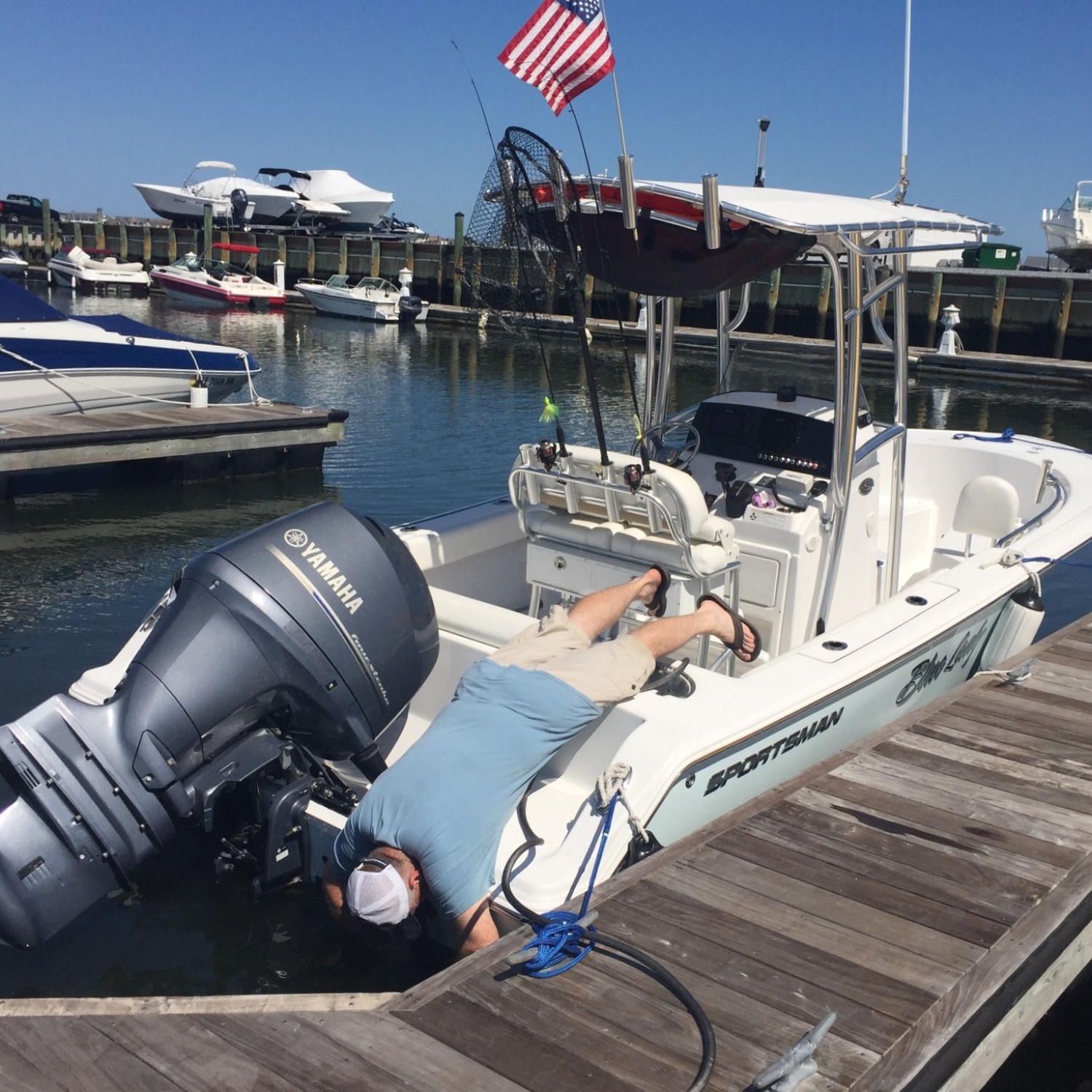 Title: Cleaning the trim tabs - On board their Sportsman Heritage 251 Center Console - Location: Stone Harbor Marina, NJ. Participating in the Photo Contest #SportsmanNovember2017