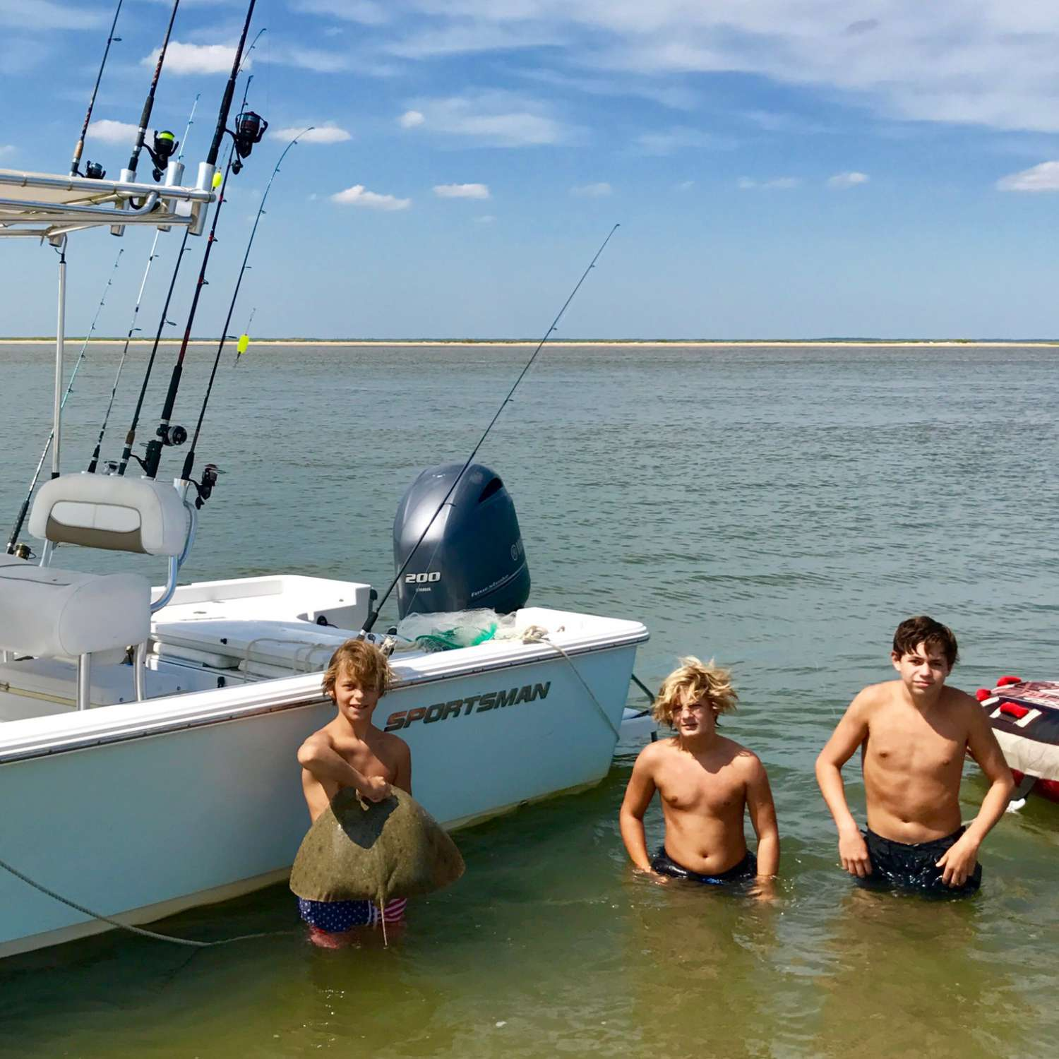 Title: Growing Up Right - On board their Sportsman Masters 227 Bay Boat - Location: Mt. Pleasant, South Carolina. Participating in the Photo Contest #SportsmanSeptember2017