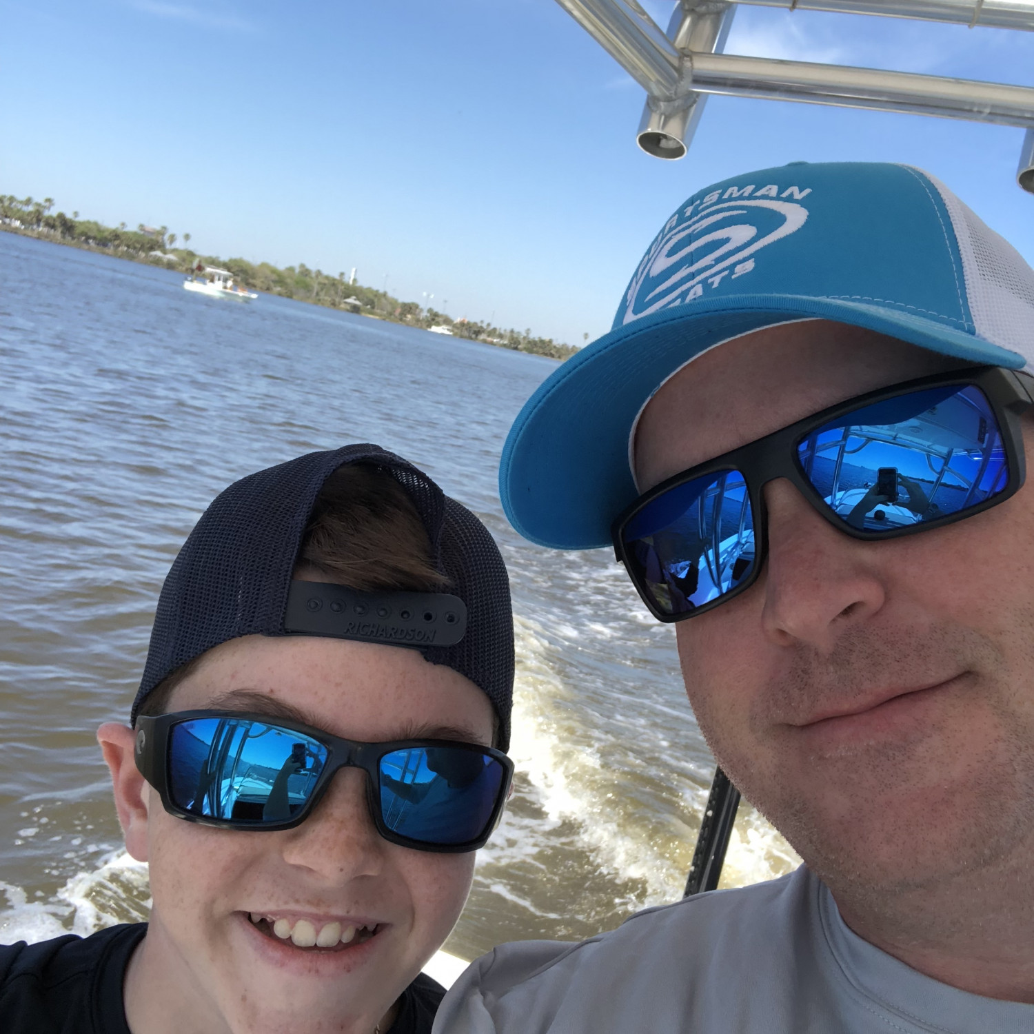 Title: Me and my oldest Enjoying our Sportsman - On board their Sportsman Masters 227 Bay Boat - Location: Ponce Inlet, Fl. Participating in the Photo Contest #SportsmanApril2018