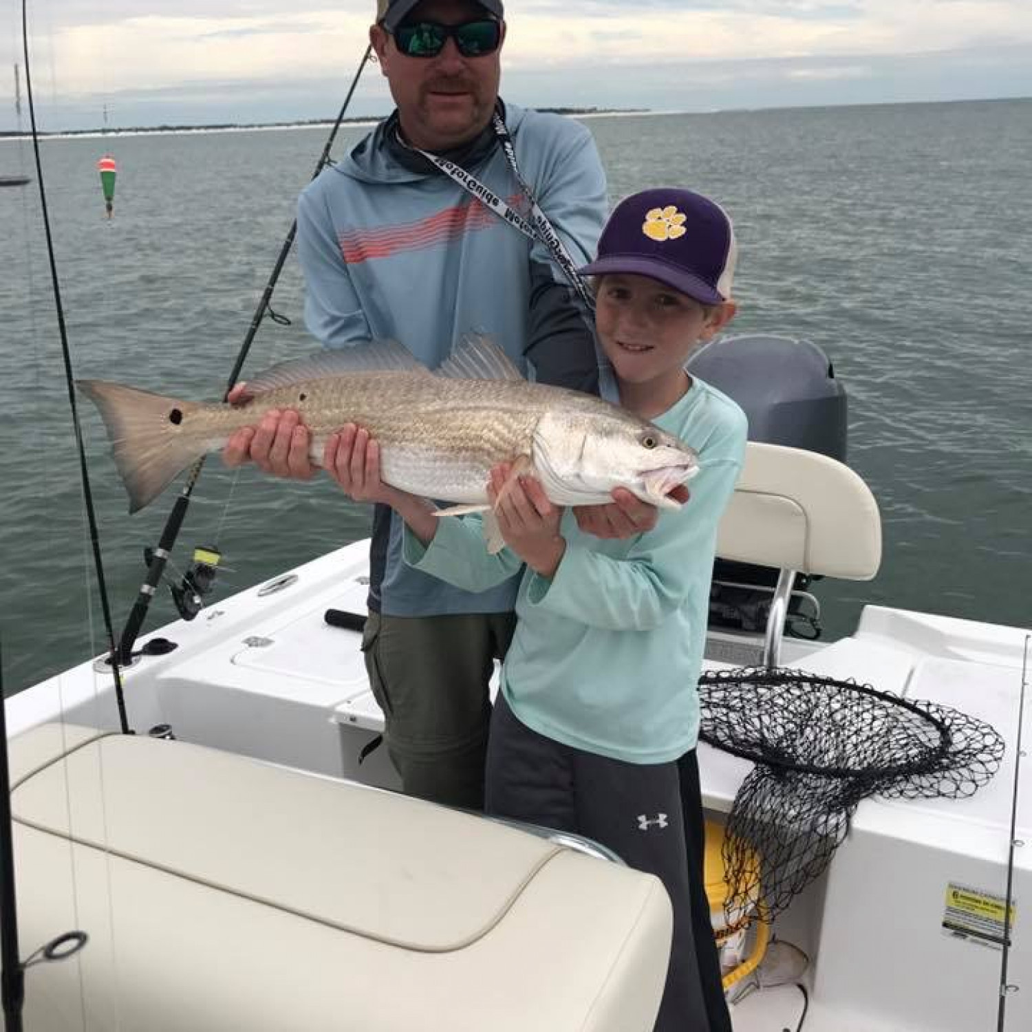 Title: Over slot redfish on light tackle. - On board their Sportsman Island Bay 20 Bay Boat - Location: Panama City FL. Participating in the Photo Contest #SportsmanApril2018