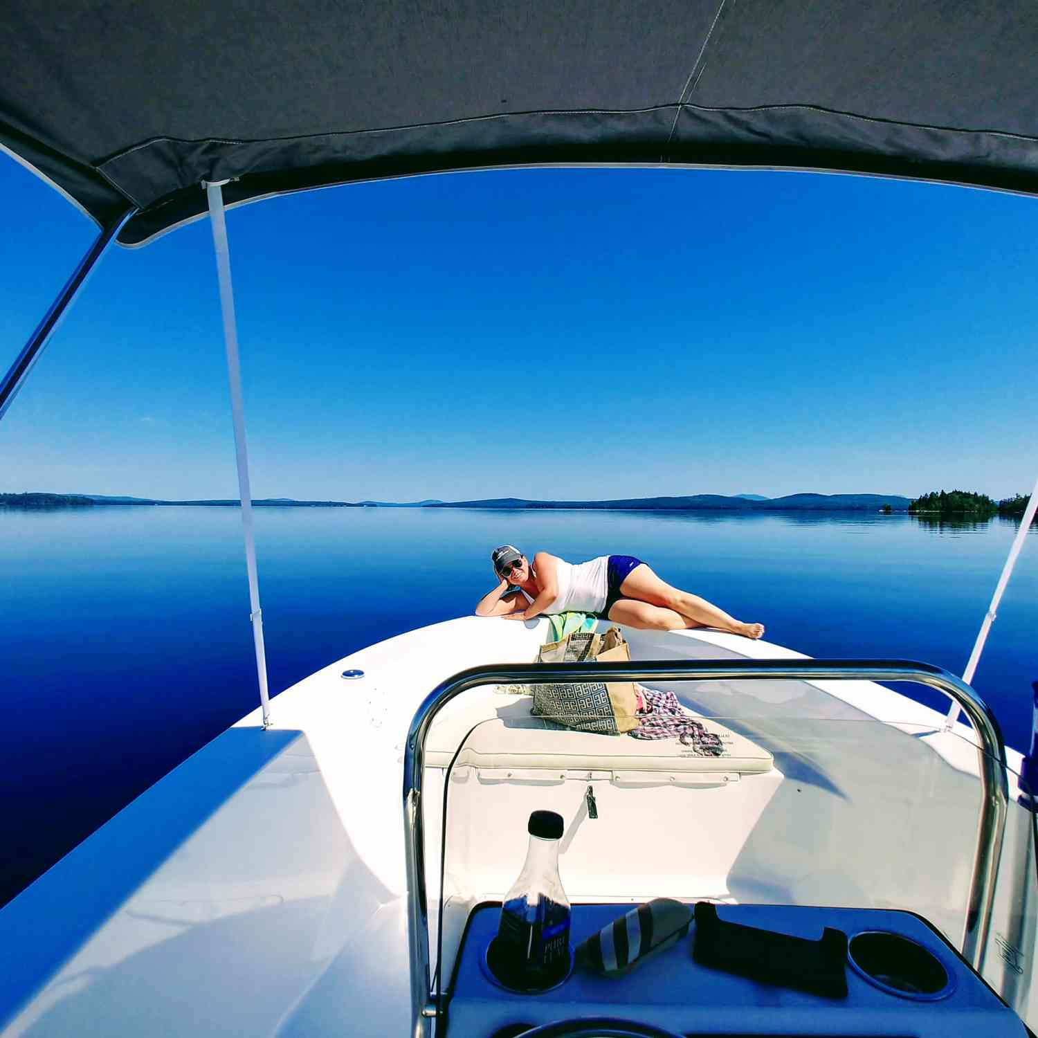 Title: Moosehead Lake Glass - On board their Sportsman Island Reef 19 Center Console - Location: Beaver Cove, ME. Participating in the Photo Contest #SportsmanAugust2018