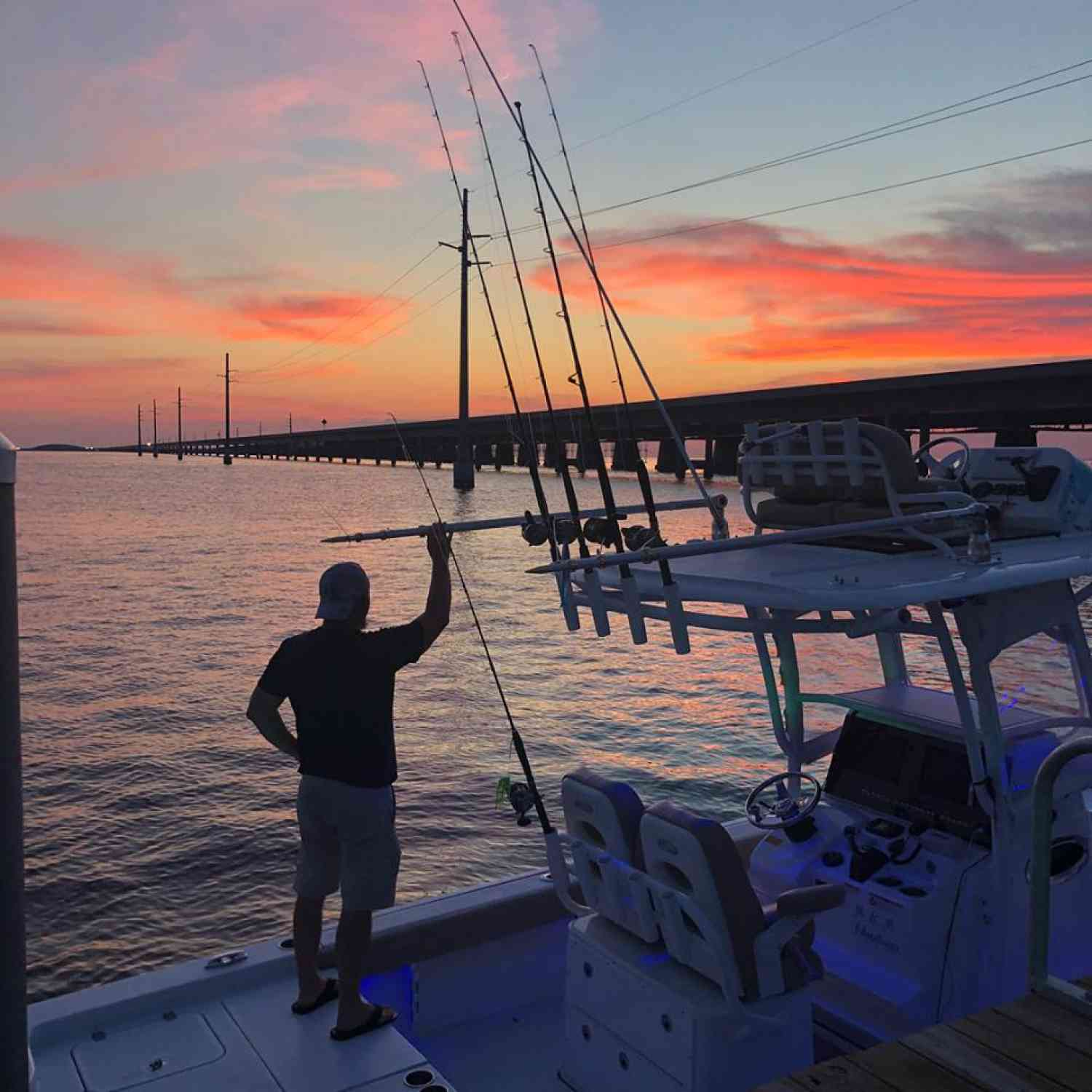 Title: Captain Mark & the Seven Mile Bridge sunset - On board their Sportsman Masters 267 Bay Boat - Location: Marathon, FL. Participating in the Photo Contest #SportsmanAugust2018