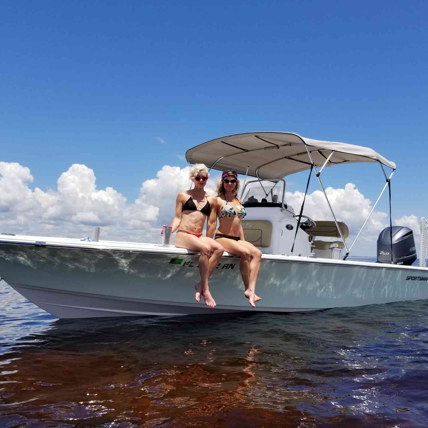 Title: Required Sportsman Accessories - On board their Sportsman Masters 247 Bay Boat - Location: St. Mark's, Florida. Participating in the Photo Contest #SportsmanAugust2018