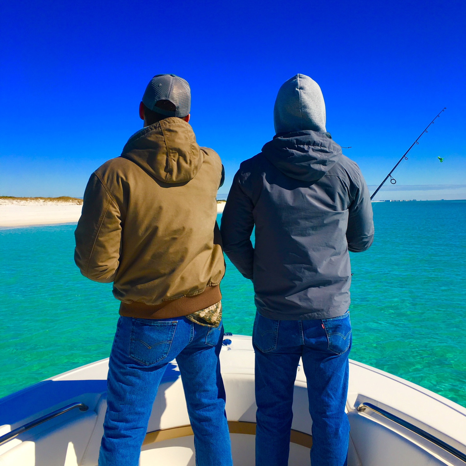 Title: Hunting Winter Redfish in Gulf just off Destin Florida - On board their Sportsman Heritage 231 Center Console - Location: Destin, FL. Participating in the Photo Contest #SportsmanFebruary2018