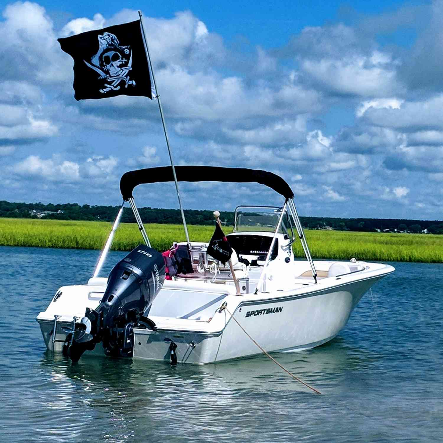 "Title: ""Aarrrgh""en't you jealous? - On board their Sportsman Heritage 211 Center Console - Location: Surf City, NC. Participating in the Photo Contest #SportsmanJuly2018"