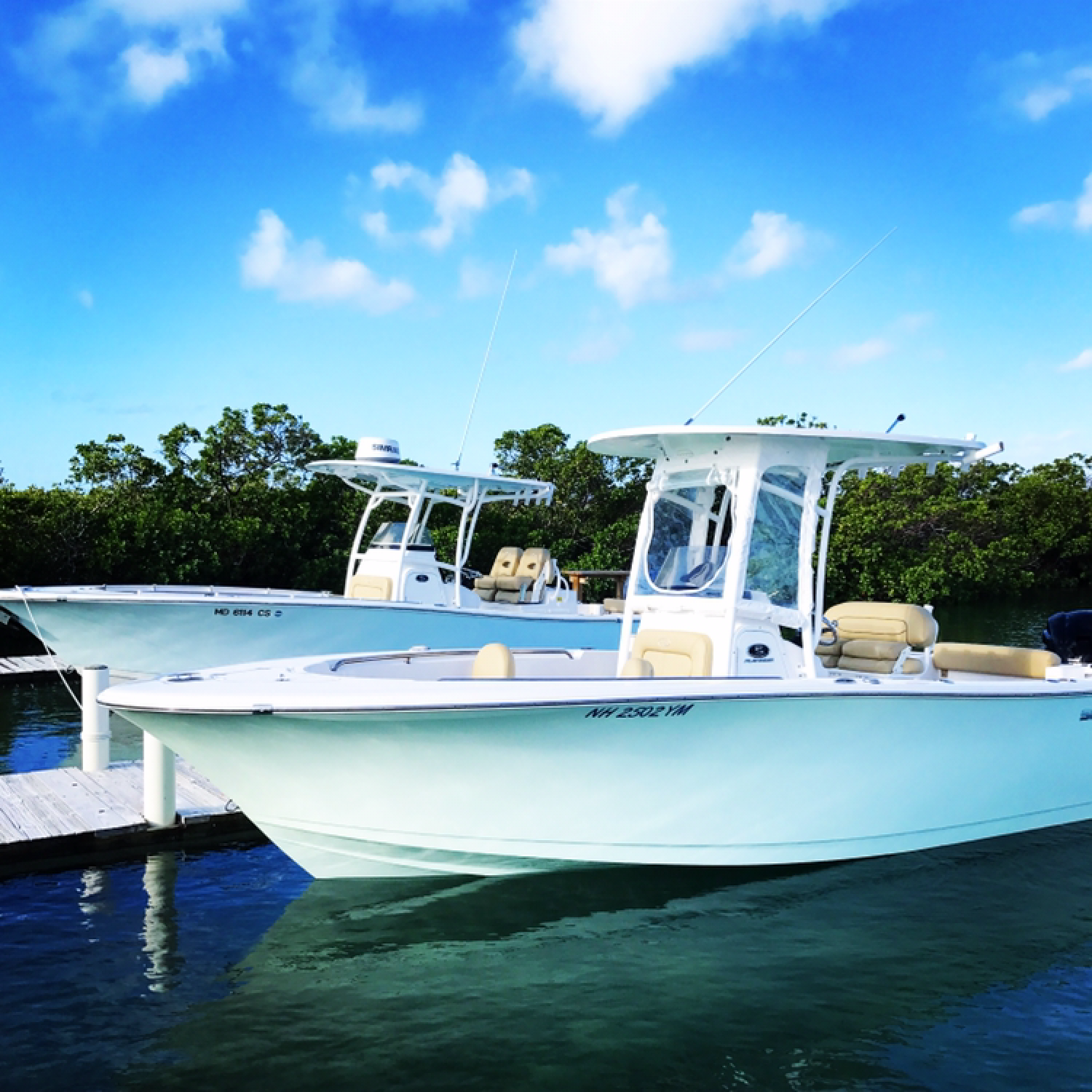 Title: Matching 232 and 282  (Long Island Bahamas) - On board their Sportsman Open 232 Center Console - Location: Long Island, Bahamas. Participating in the Photo Contest #SportsmanMarch2018