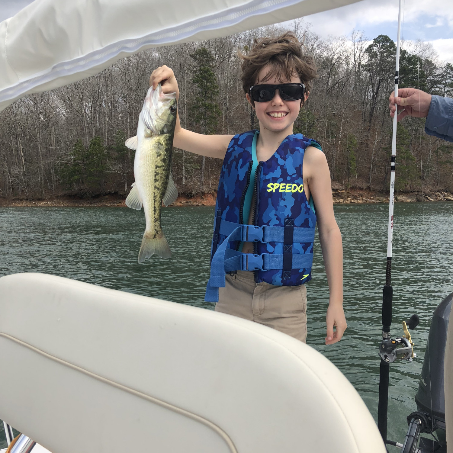 Title: First Bass - On board their Sportsman Island Bay 20 Bay Boat - Location: Lake Hartwell Clemson, SC. Participating in the Photo Contest #SportsmanMarch2018
