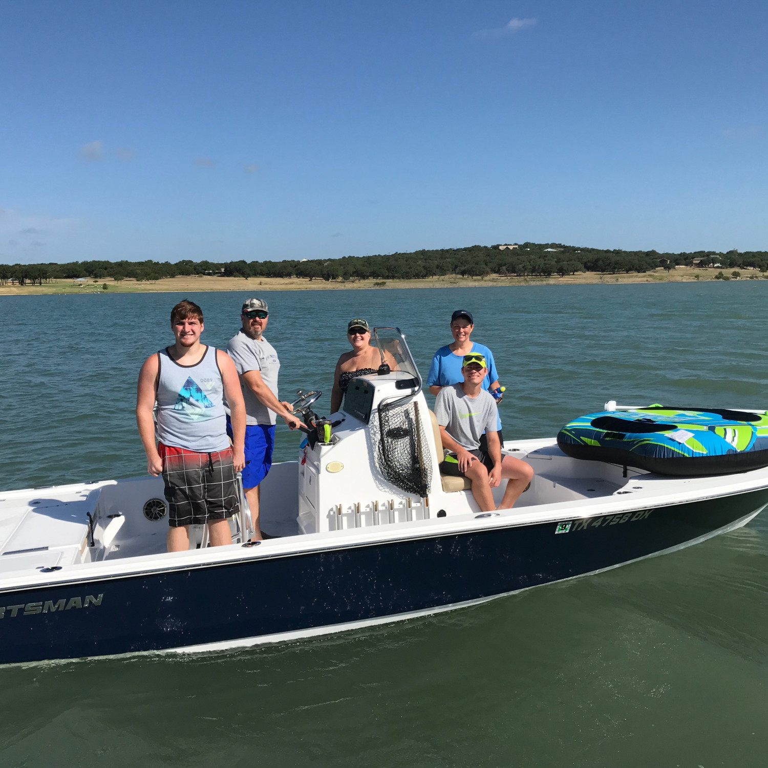 Title: Going Tubing - On board their Sportsman Tournament 234 Bay Boat - Location: Canyan Lake, Texas. Participating in the Photo Contest #SportsmanMarch2018