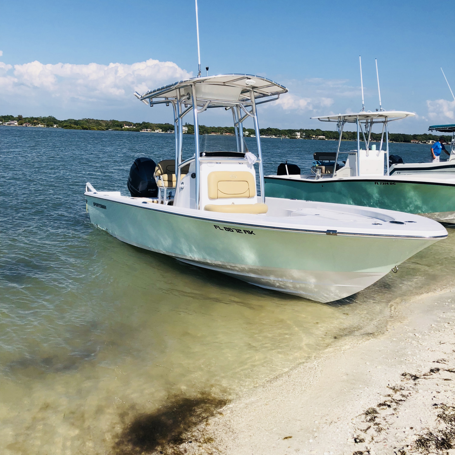 Title: Beached - On board their Sportsman Masters 227 Bay Boat - Location: St. Petersburg, Florida. Participating in the Photo Contest #SportsmanMay2018