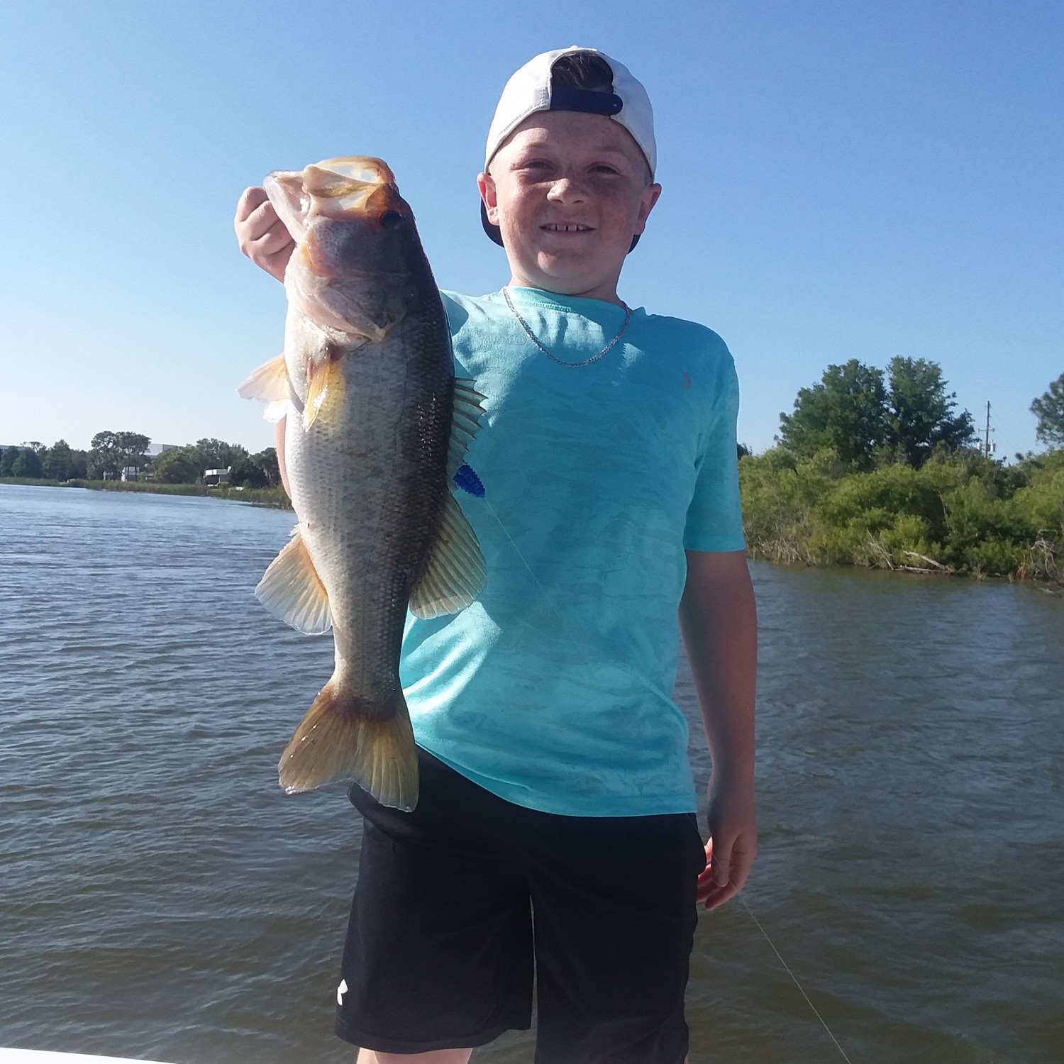 Title: First fish caught on the new boat - On board their Sportsman Island Bay 20 Bay Boat - Location: Sebring, Fl. Participating in the Photo Contest #SportsmanMay2018