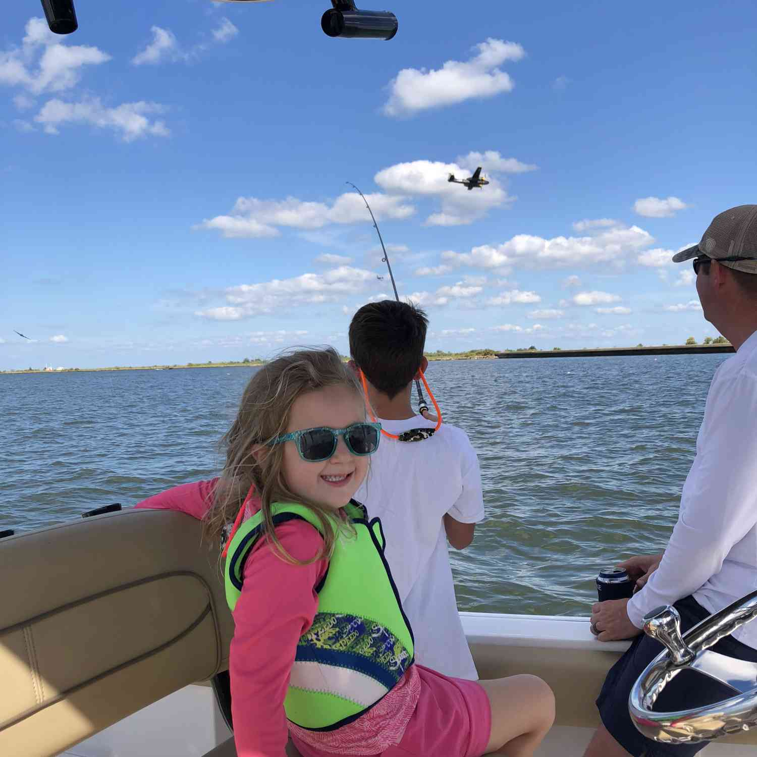 Title: All Smiles - On board their Sportsman Open 232 Center Console - Location: New Orleans Lakefront. Participating in the Photo Contest #SportsmanOctober2018