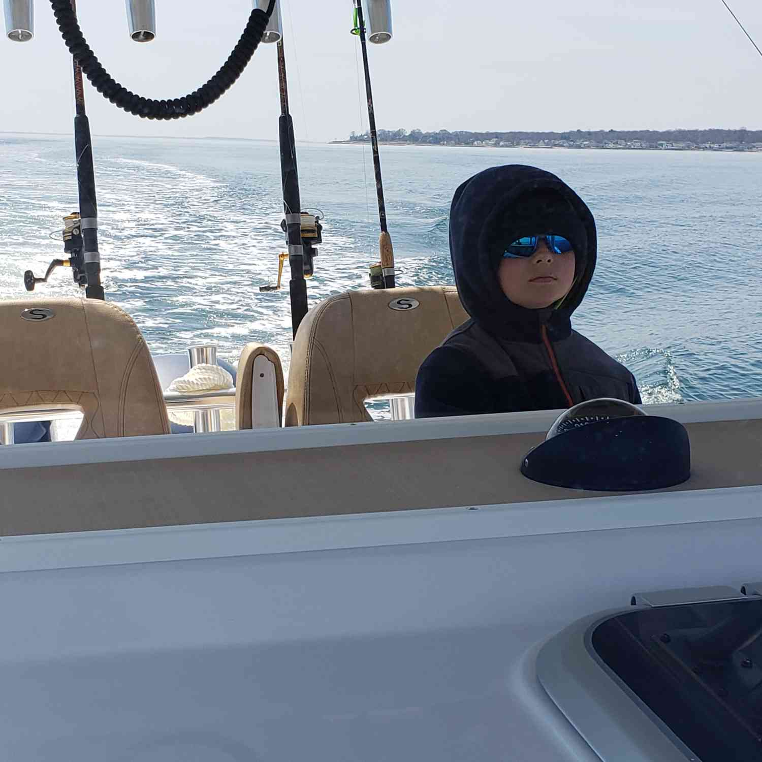 Title: Little man at the helm!!!! - On board their Sportsman Open 312 Center Console - Location: Niantic ct. Participating in the Photo Contest #SportsmanApril2019
