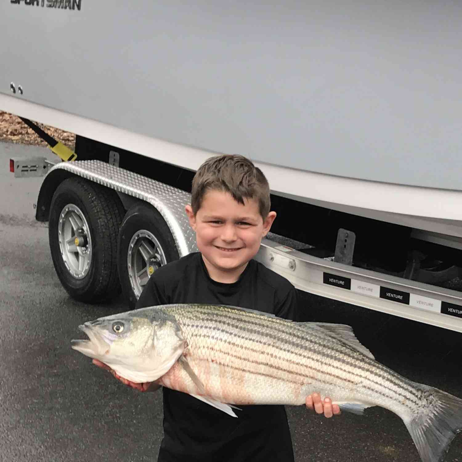 Title: First striper on the new boat - On board their Sportsman Open 232 Center Console - Location: Raritan Bay New Jersey. Participating in the Photo Contest #SportsmanApril2019