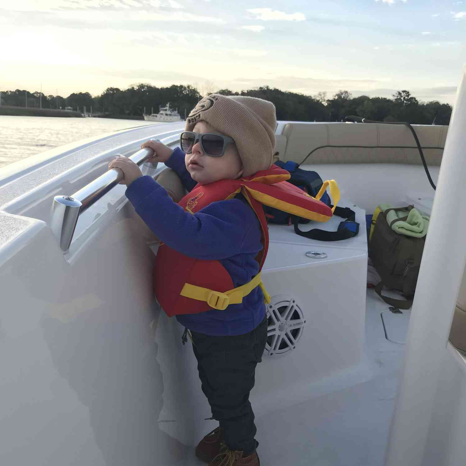 Title: A chilly morning but a great day for his first ride! - On board their Sportsman Heritage 211 Center Console - Location: Charleston, SC. Participating in the Photo Contest #SportsmanApril2019