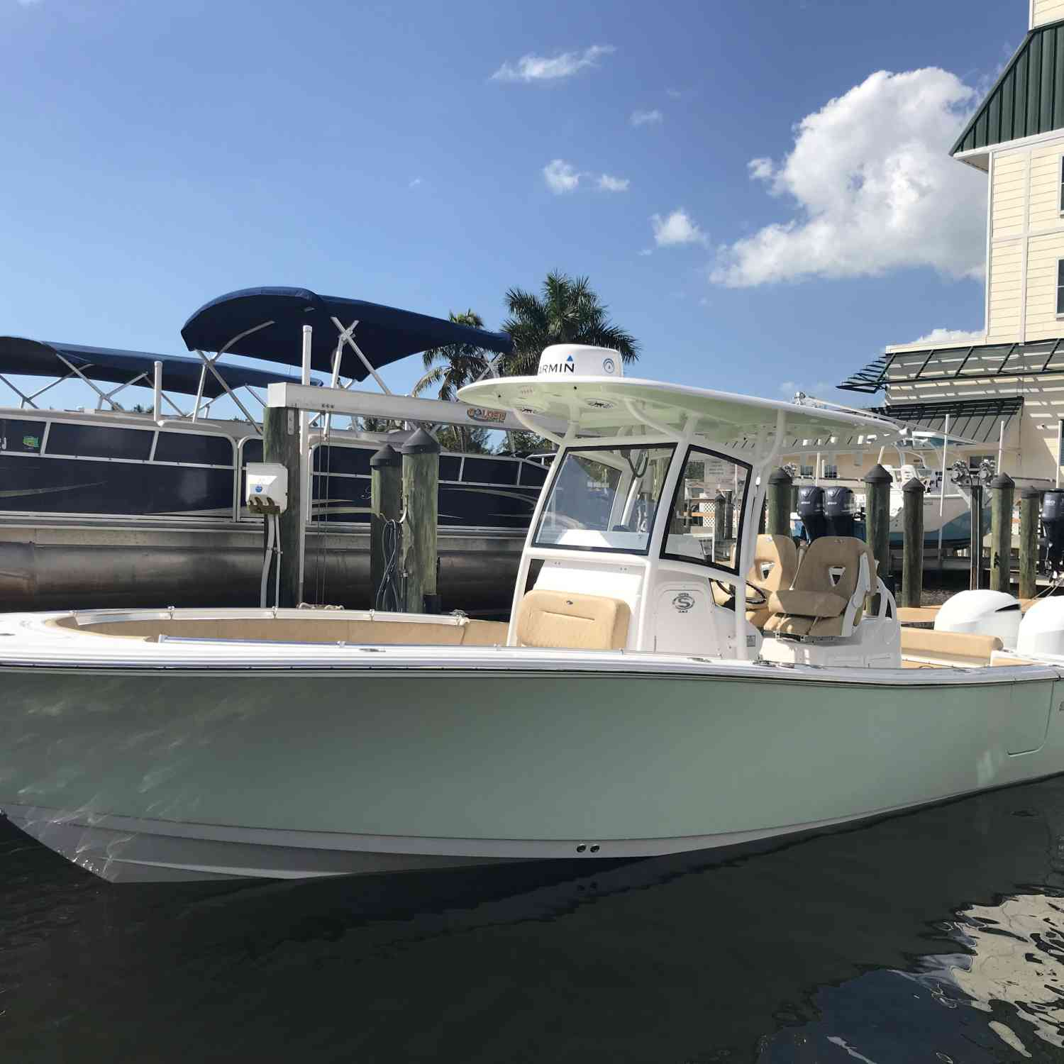 Title: She is Home - On board their Sportsman Open 282 Center Console - Location: Bonita Springs Florida. Participating in the Photo Contest #SportsmanApril2019