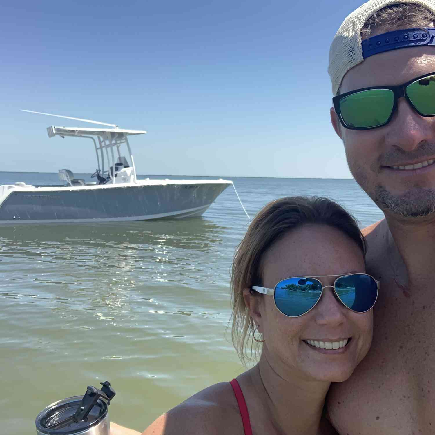 Title: True Love! - On board their Sportsman Open 232 Center Console - Location: Mosquito Lagoon, FL. Participating in the Photo Contest #SportsmanDecember2019