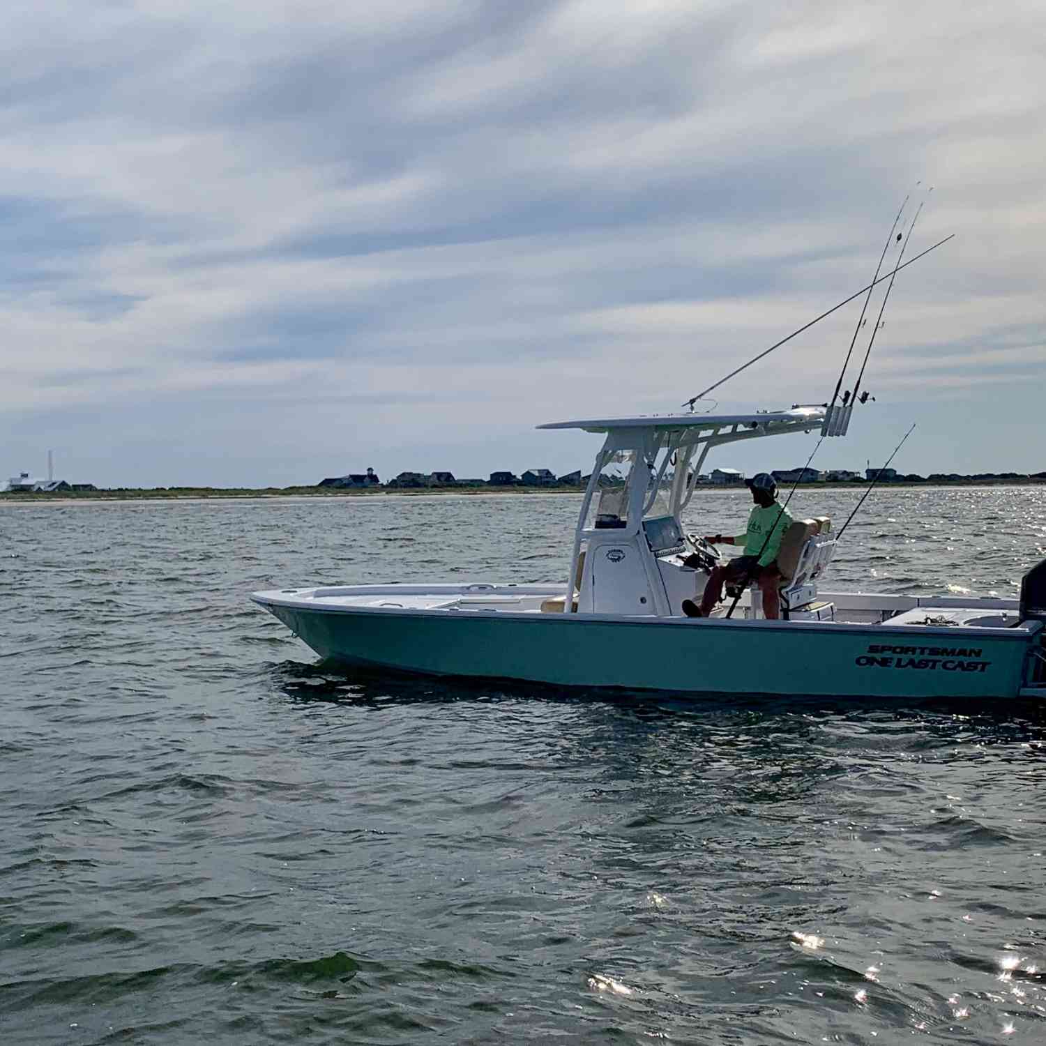Title: ONE LAST CAST - On board their Sportsman Masters 247 Bay Boat - Location: Southport NC. Participating in the Photo Contest #SportsmanJuly2019