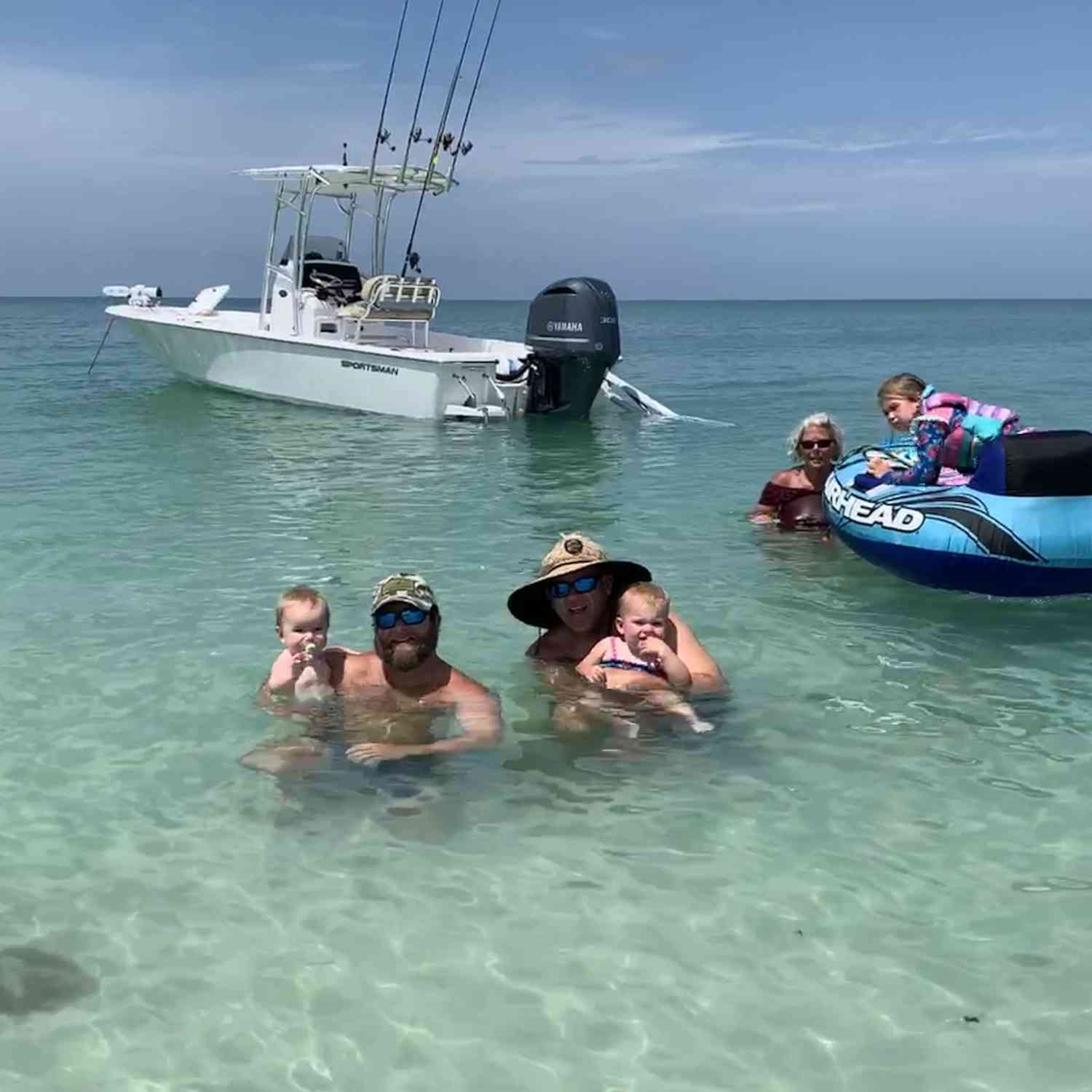 Title: Cooling off - On board their Sportsman Masters 247 Bay Boat - Location: Casey key FL. Participating in the Photo Contest #SportsmanJuly2019