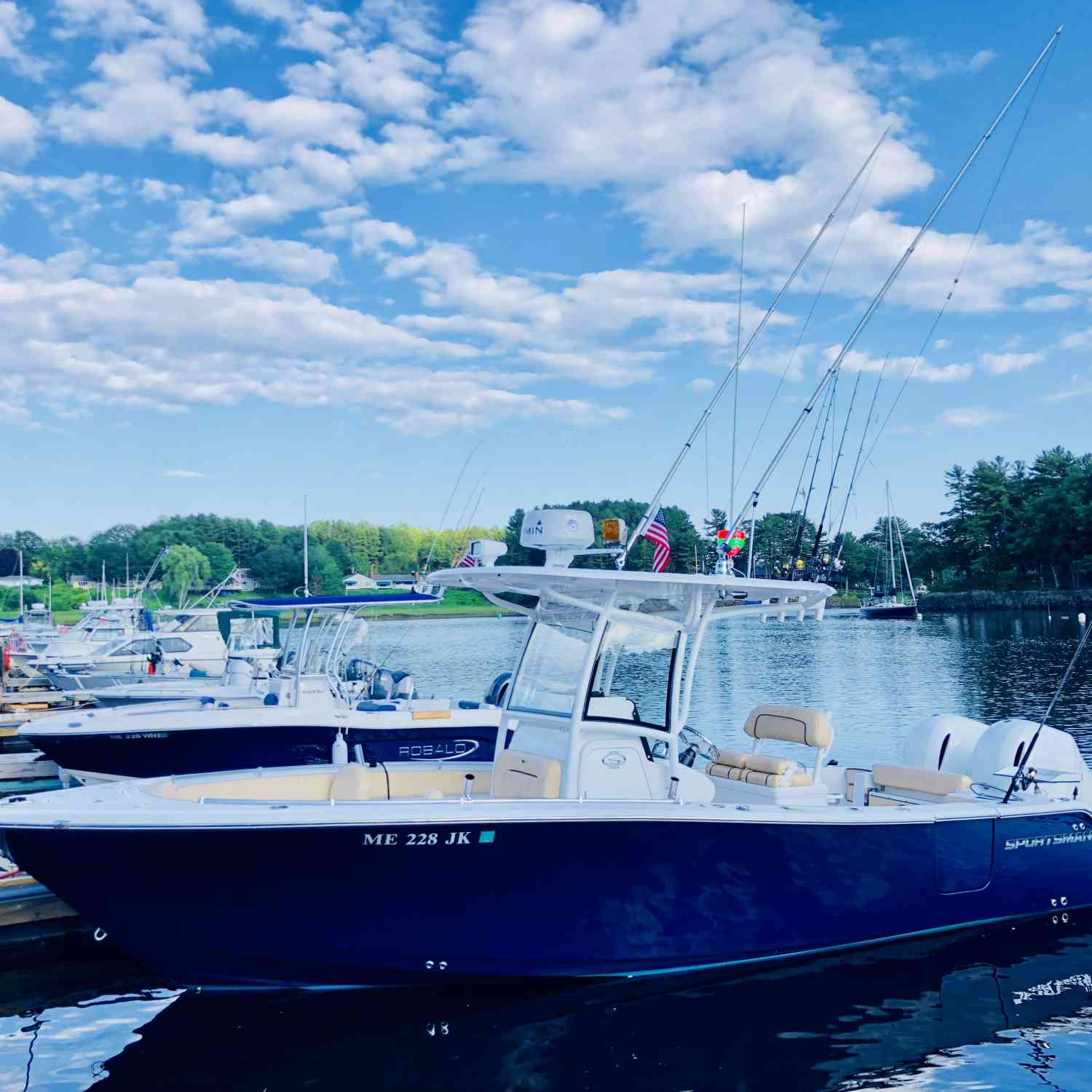 Title: Chilling at the dock - On board their Sportsman Open 252 Center Console - Location: Saco MAINE. Participating in the Photo Contest #SportsmanJuly2019