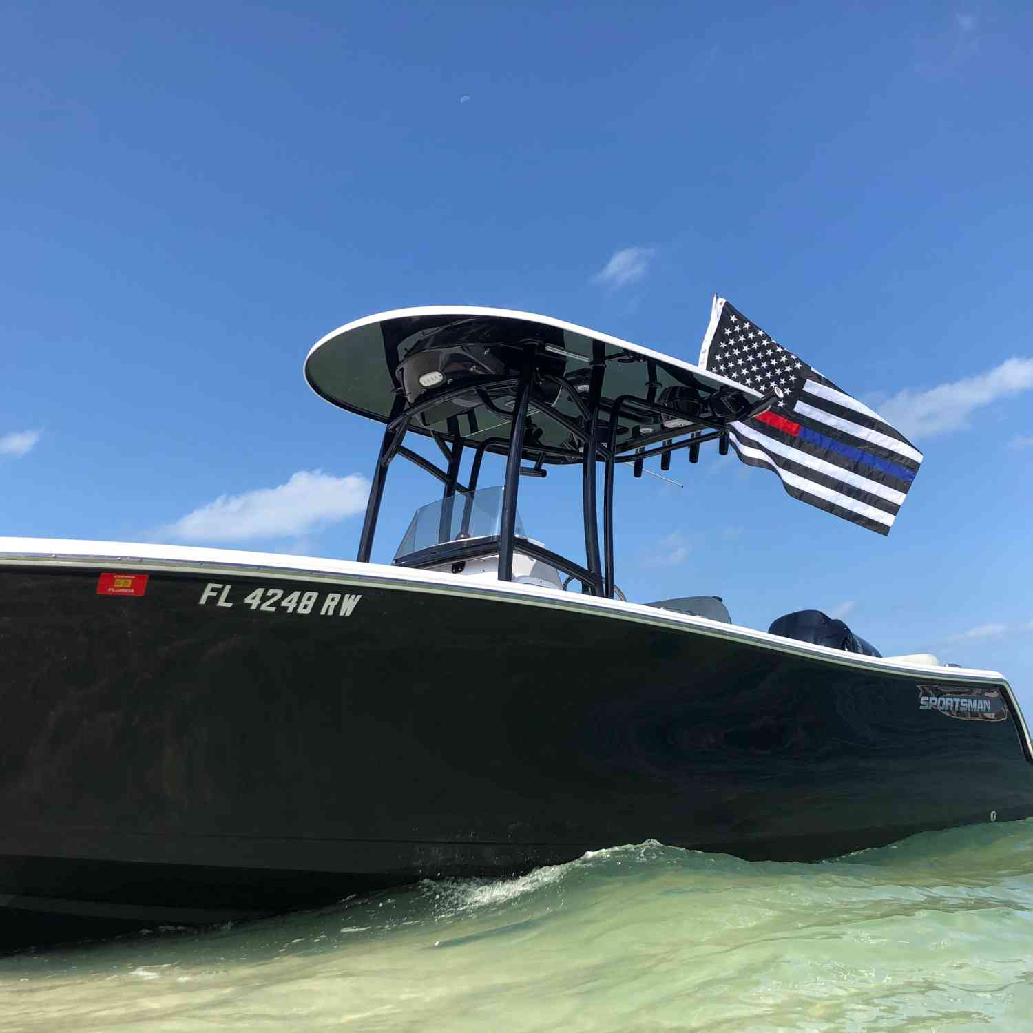 Title: Shady Liberty - On board their Sportsman Heritage 231 Center Console - Location: Naples Florida. Participating in the Photo Contest #SportsmanJune2019