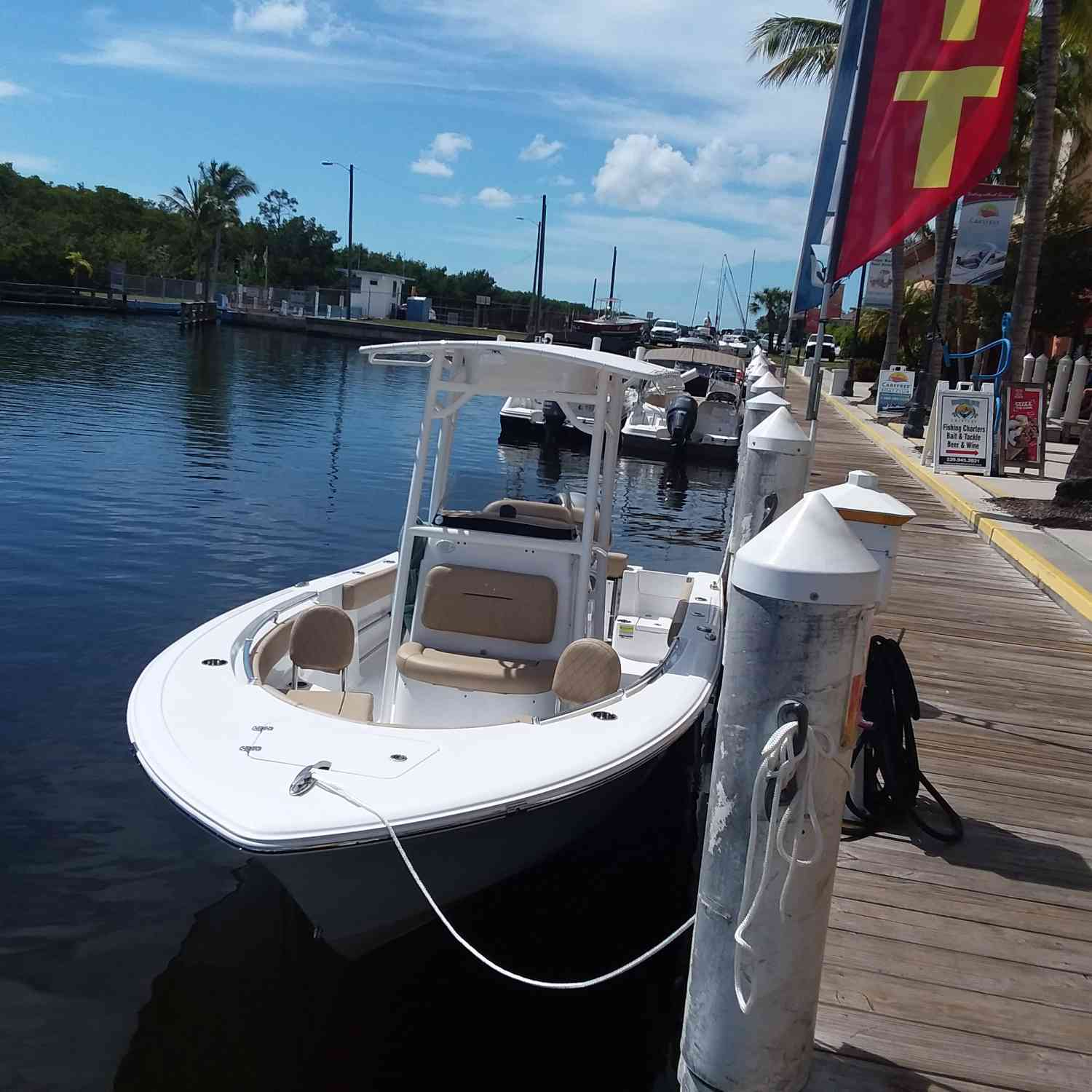 Title: Little beauty at rest - On board their Sportsman Open 212 Center Console - Location: Cape Coral Florida. Participating in the Photo Contest #SportsmanMarch2019
