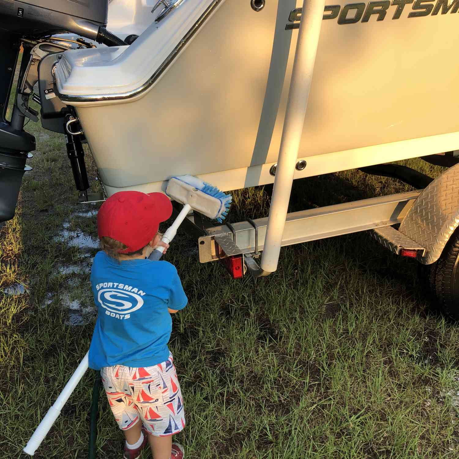 Title: Grandpa's First Mate - On board their Sportsman Open 212 Center Console - Location: Sullivan's Island, SC. Participating in the Photo Contest #SportsmanMay2019