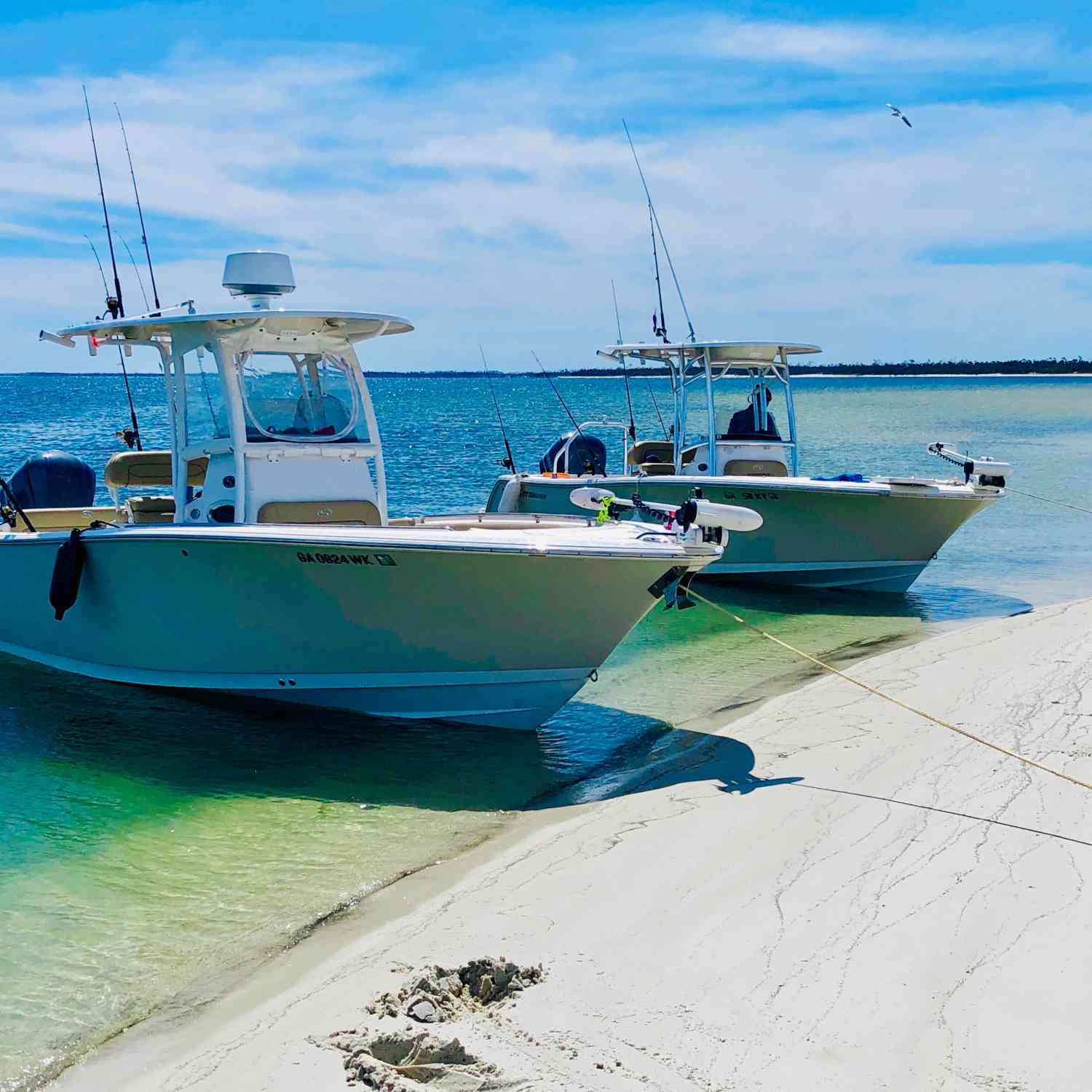 Title: Twins at the sandbar - On board their Sportsman Heritage 231 Center Console - Location: Cape San Blaas.. Participating in the Photo Contest #SportsmanApril2020