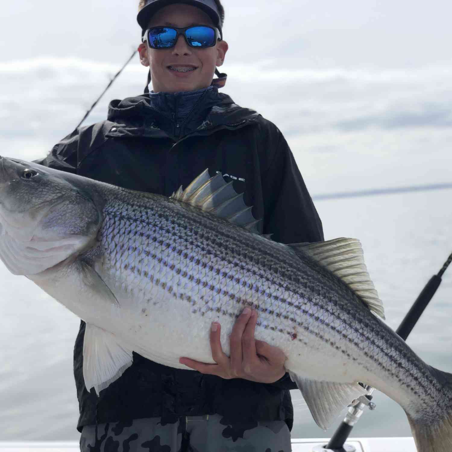 Title: Giant Rockfish in the Chesapeake Bay! - On board their Sportsman Open 252 Center Console - Location: Maryland. Participating in the Photo Contest #SportsmanApril2020