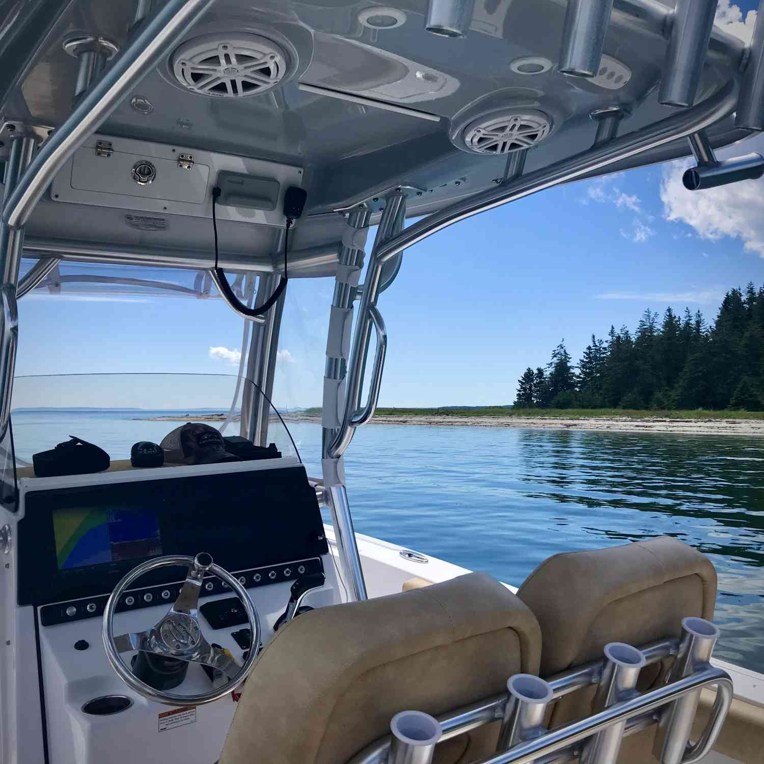 Title: Vitamin D day - On board their Sportsman Heritage 241 Center Console - Location: Long Island (west of Acadia National Park), Maine. Participating in the Photo Contest #SportsmanAugust2020