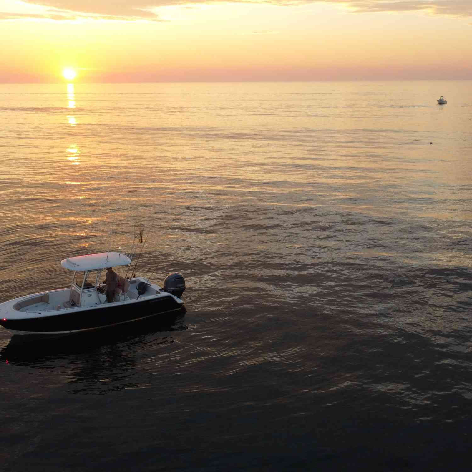 Title: Sunrise Fishing - On board their Sportsman Heritage 241 Center Console - Location: MA / NH state line.. Participating in the Photo Contest #SportsmanAugust2020